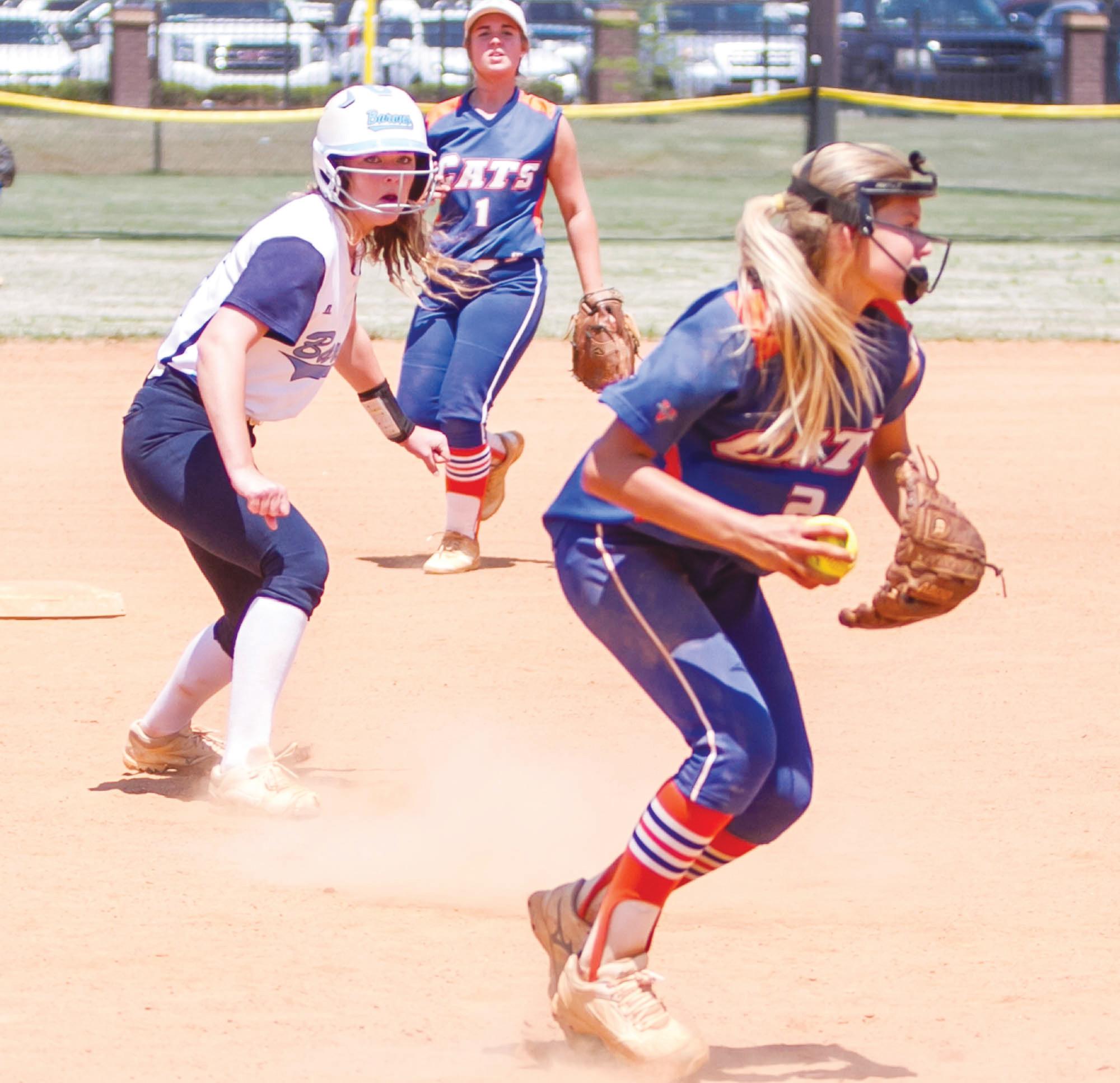 Laurence Manning's XXX holds a Wilson Hall baserunner at second before going to first for the out during the Lady Swampcats' 10-0 loss to archrival Wilson Hall in the state 1A championship series.
