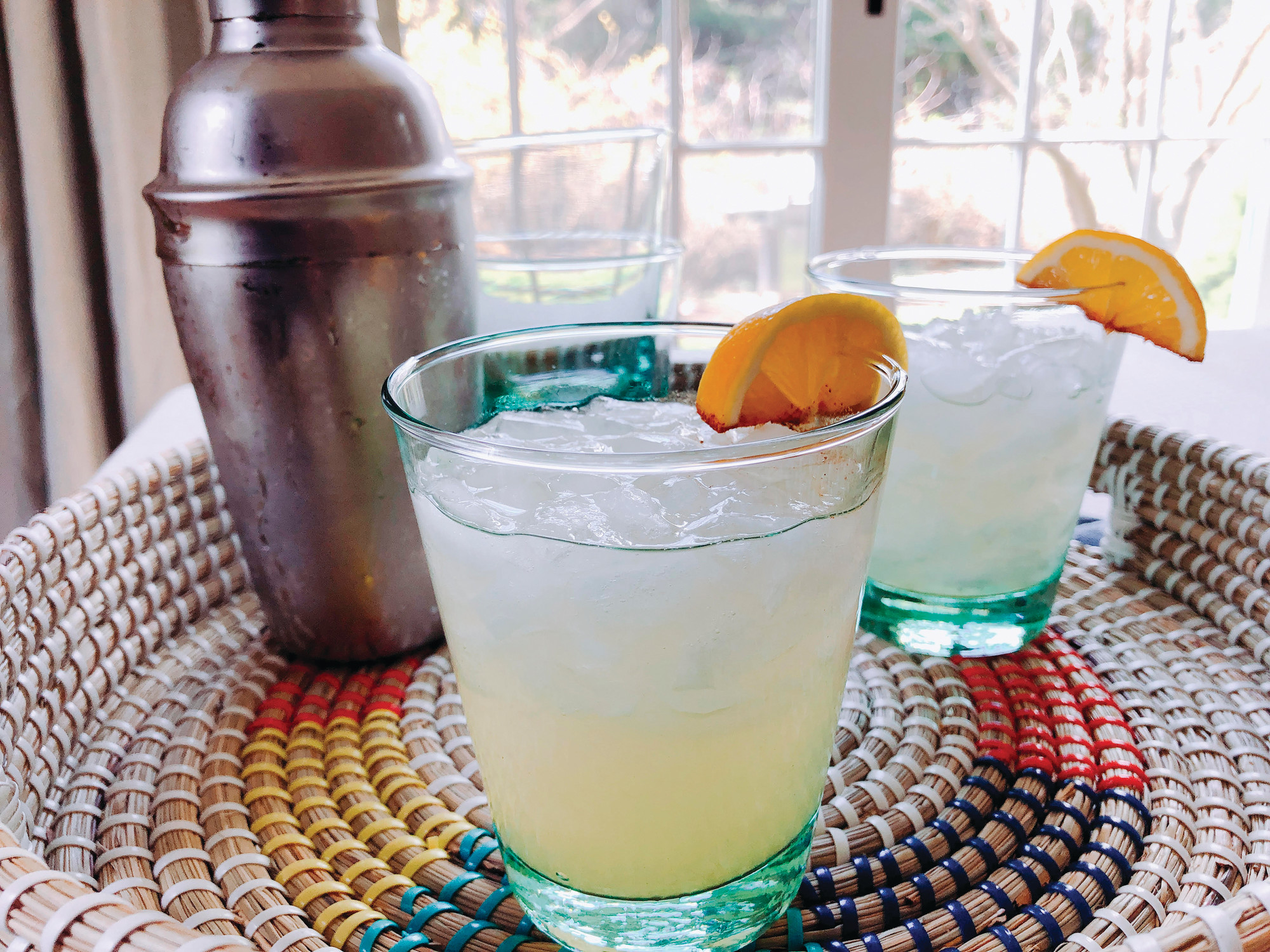 "THE ASSOCIATED PRESSA ""Skinny"" Mango Margarita is garnished with a slice of citrus dipped in cinnamon in Amagansett, New York. The recipe by Elizabeth Karmel calls for a tequila-based mango liqueur for flavor and sweetness, plus silver tequila and fresh-squeezed Meyer lemon juice."