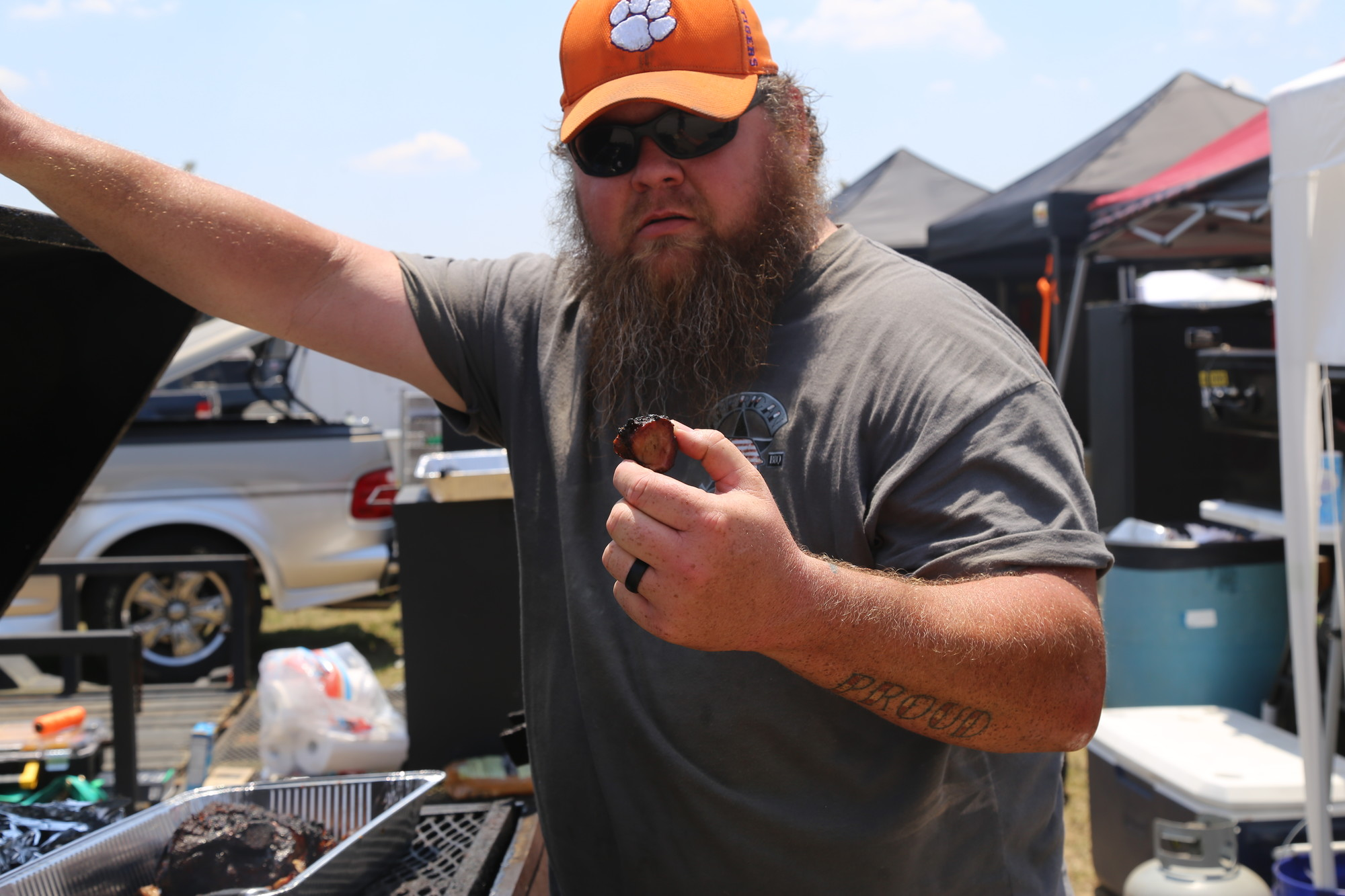 Chad Porter shows off his American Proud BBQ entry for the cook-off on Saturday at the Sumter County Fairgrounds.