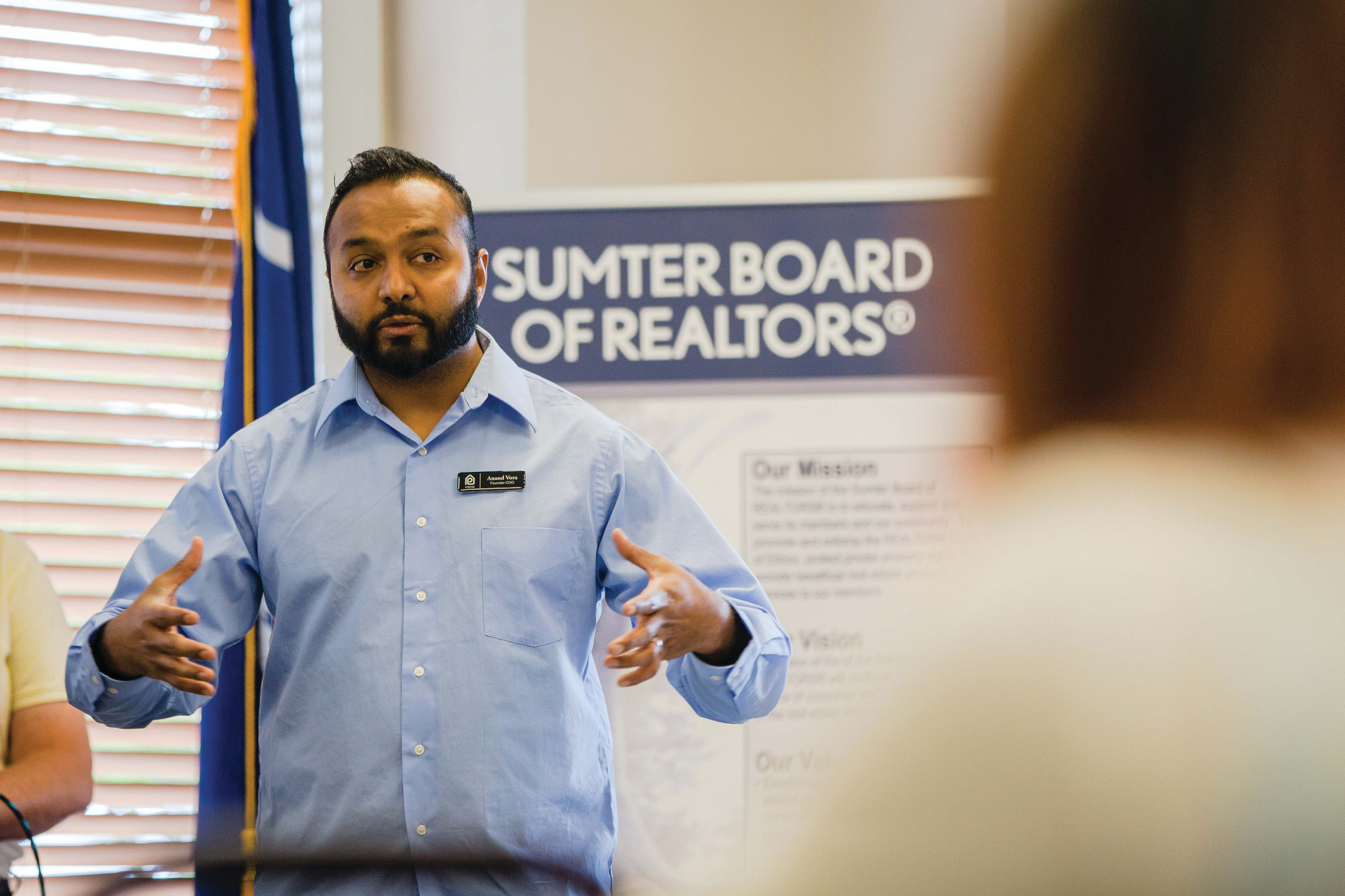 Anand Vora, founder of the PORCHD mobile device application, explains the new real estate app to Realtors on Wednesday during a presentation at the Sumter Board of Realtors.