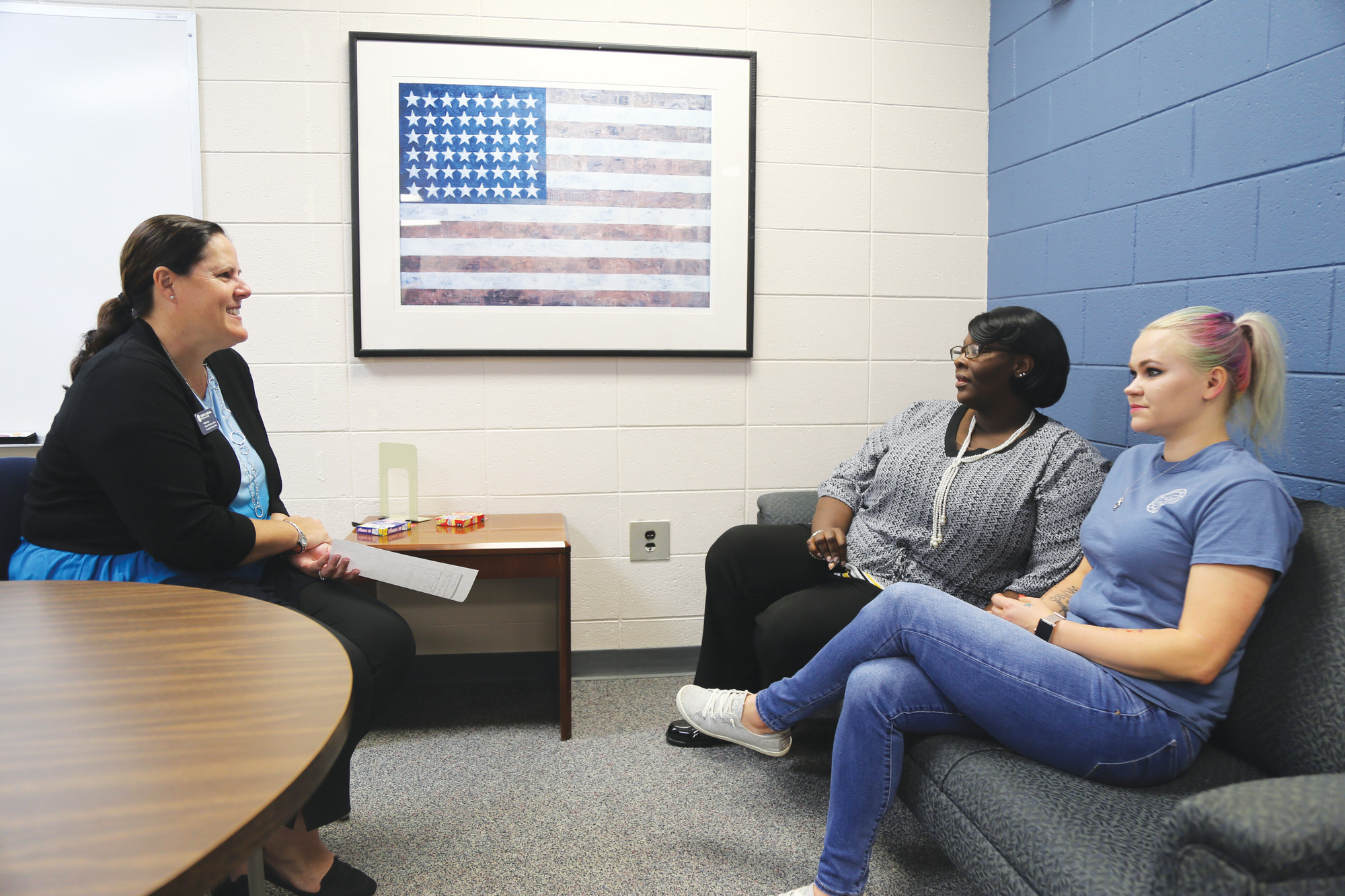 BRUCE MILLS / THE SUMTER ITEMFrom left, Central Carolina Technical College's Veterans' Affairs Representative Heather Hearn talks Wednesday with military veteran students Margaret Nelson and Rachael Wallace about their experiences at the school.