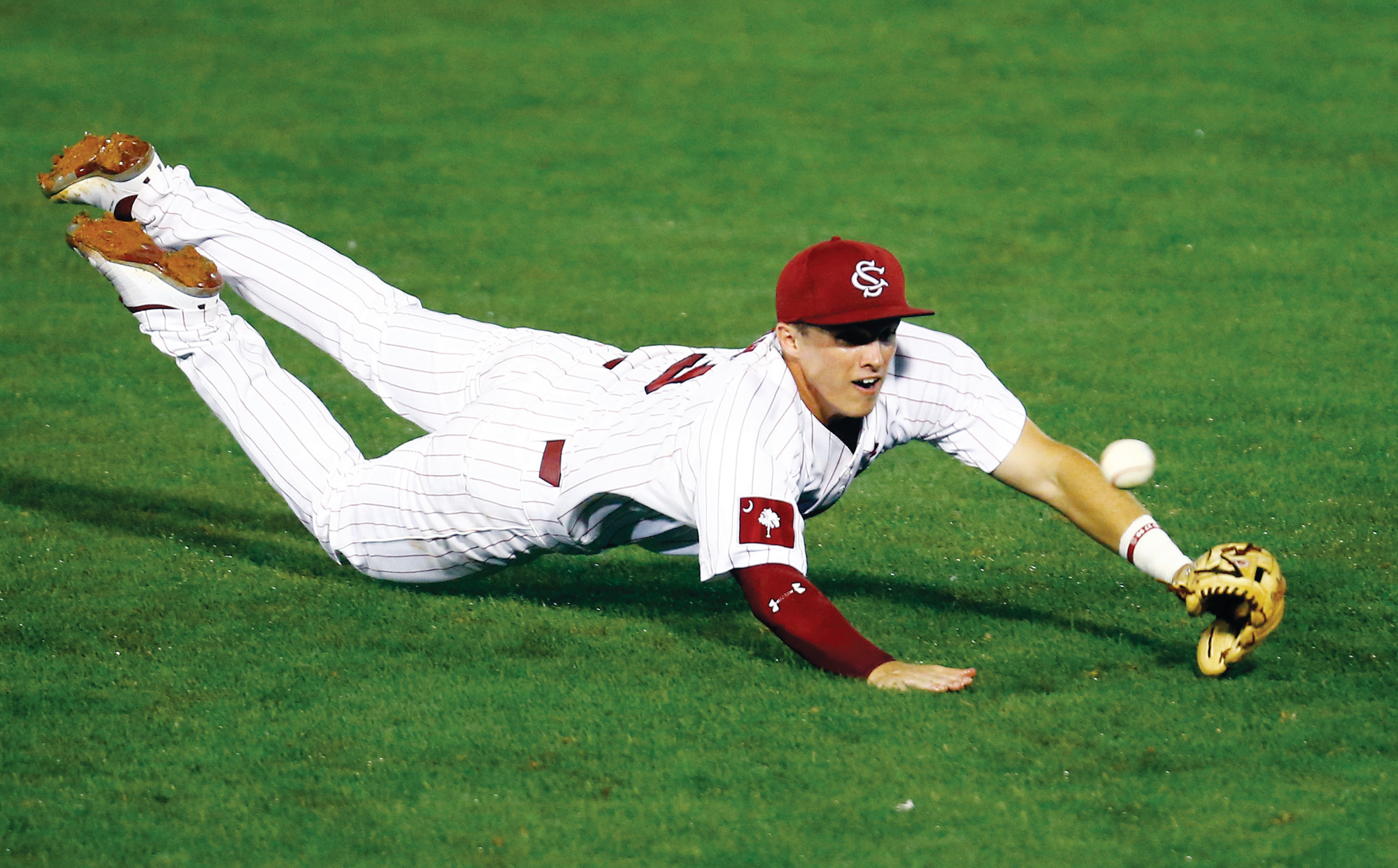 THE ASSOCIATED PRESS  South Carolina infielder Justin Row dives for a ground ball during the fourth inning of the Gamecocks' 4-2 victory over Missouri on Tuesday in the Southeastern Conference tournament on Tuesday in Hoover, Alabama. USC was facing Arkansas on Wednesday.