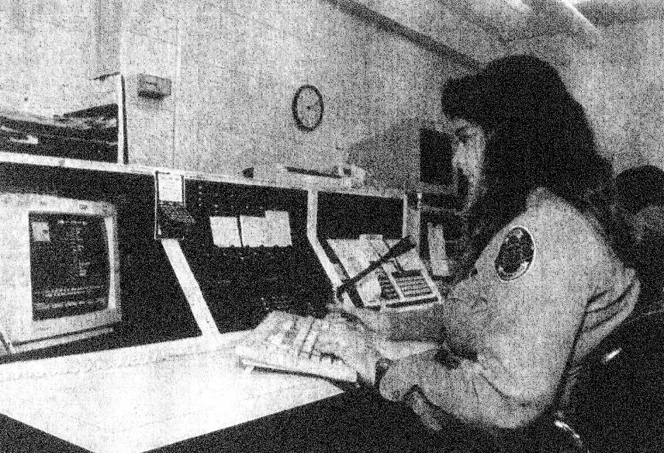 "1993 - Jackie McLeod, a telecommunicator in the Sumter City-County Law Enforcement Center, types information into her computer. McLeod said dispatching is a constant challenge because one ""can never tell what is going to happen out there."""