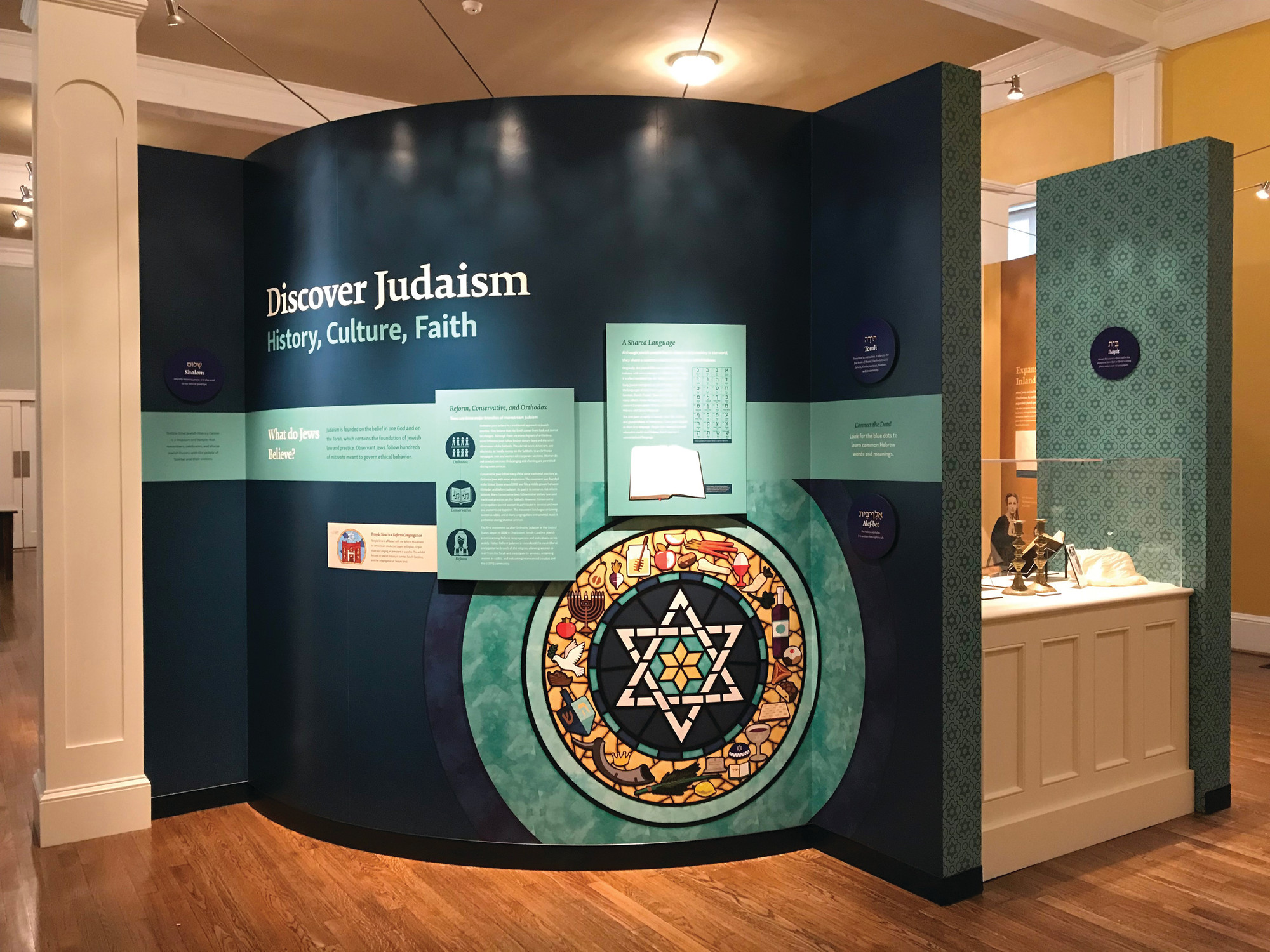 "The first exhibit visitors to the Temple Sinai Jewish History Center will see is ""Discover Judaism,"" which offers an explanation of the traditions of the religion."