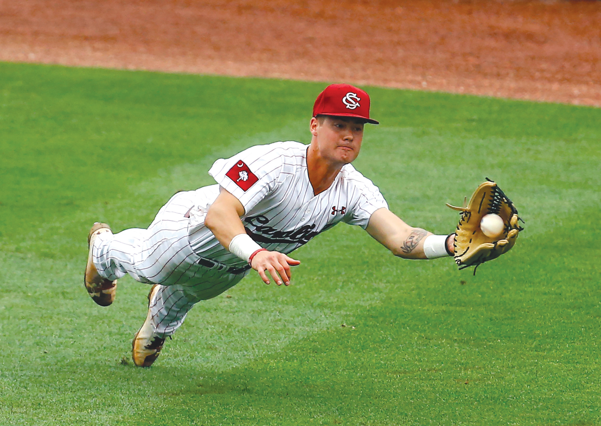 South Carolina outfielder Jacob Olson (7) makes a diving catch for the out of LSU's Zach Watson (9) during the ninth inning of a Southeastern Conference Tournament NCAA college baseball game Thursday in Hoover, Alabama.