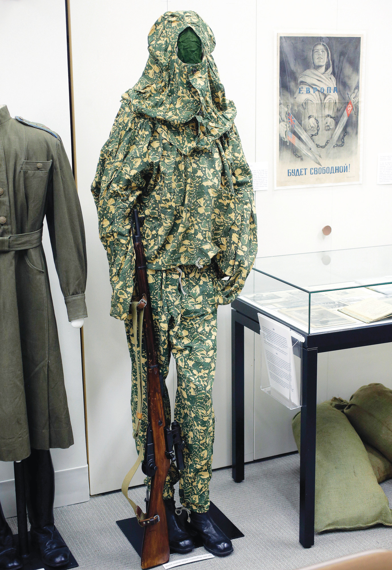 "A World War II Soviet women's camouflaged sniper uniform is displayed with a sniper rifle in an exhibit called ""Women in WWII: On the Home Fronts and the Battlefronts"" at The International Museum of World War II in Natick, Massachusetts."