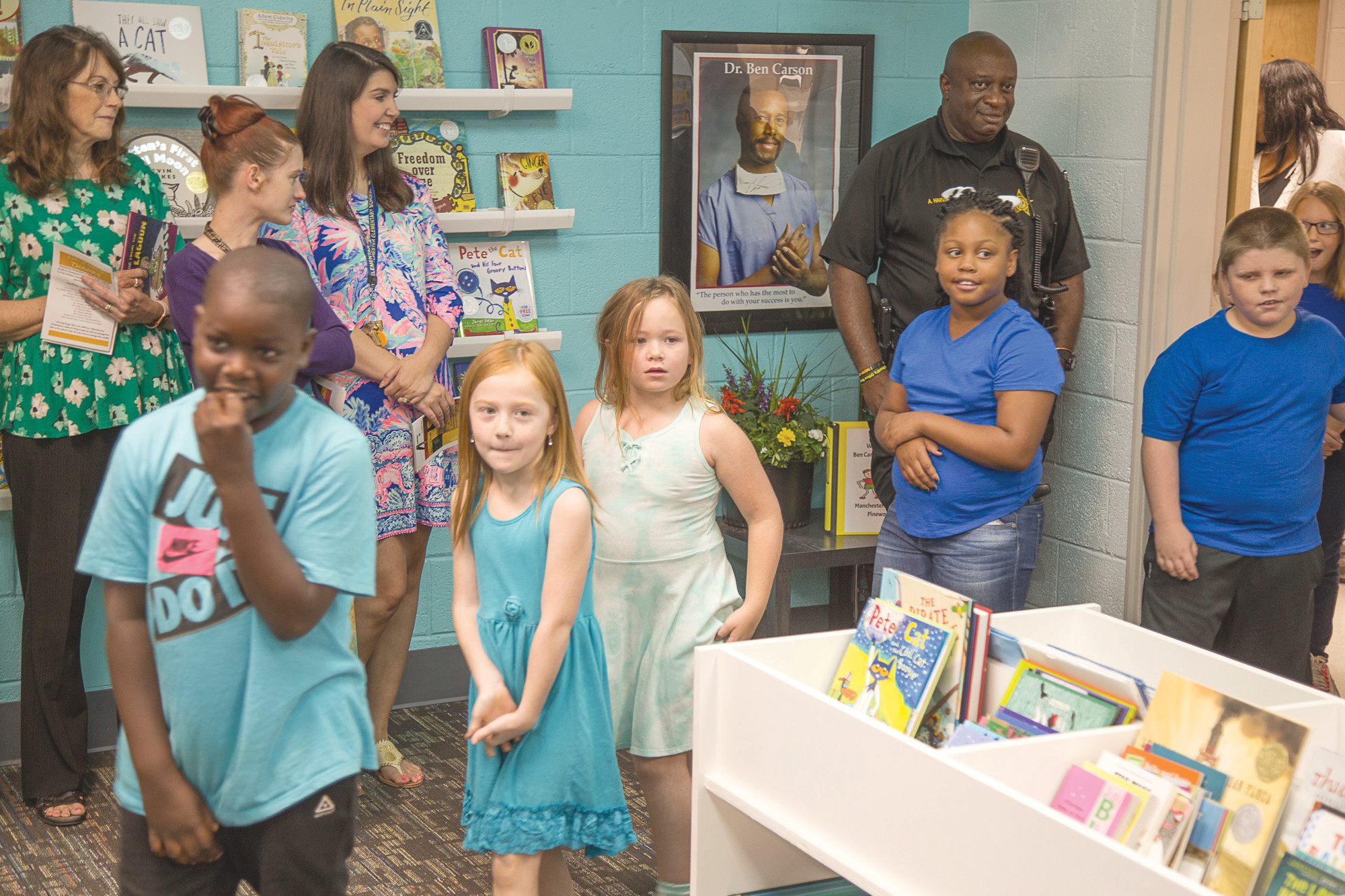 Manchester Elementary School students enter the school's new Ben Carson Reading Room on Tuesday.