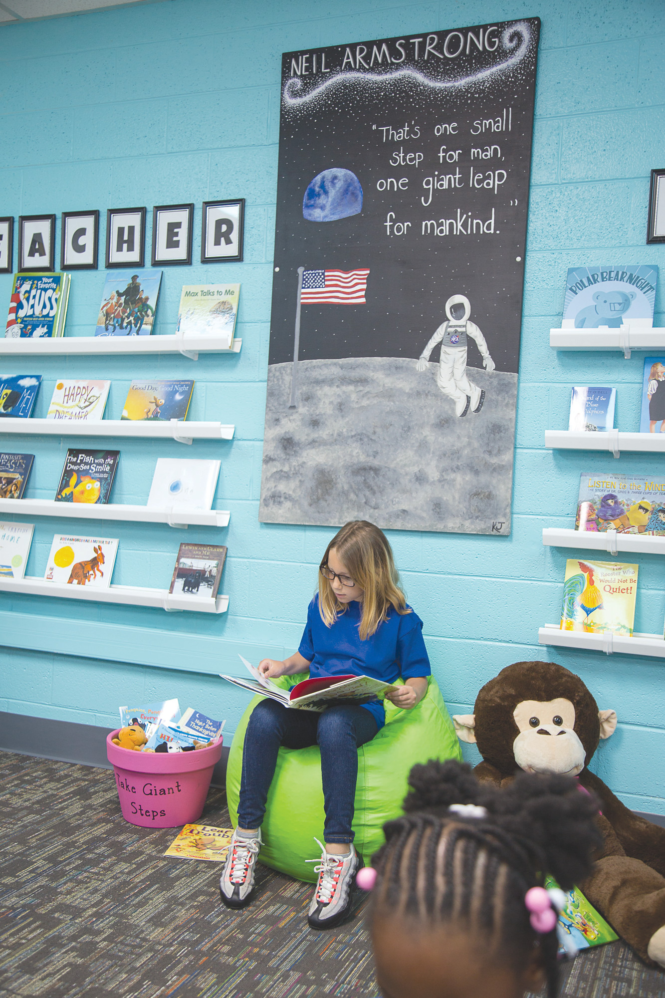 "Manchester Elementary School's theme for its new reading room is ""Giant Steps to Change the World,"" based on the book by Spike and Tonya Lewis Lee."