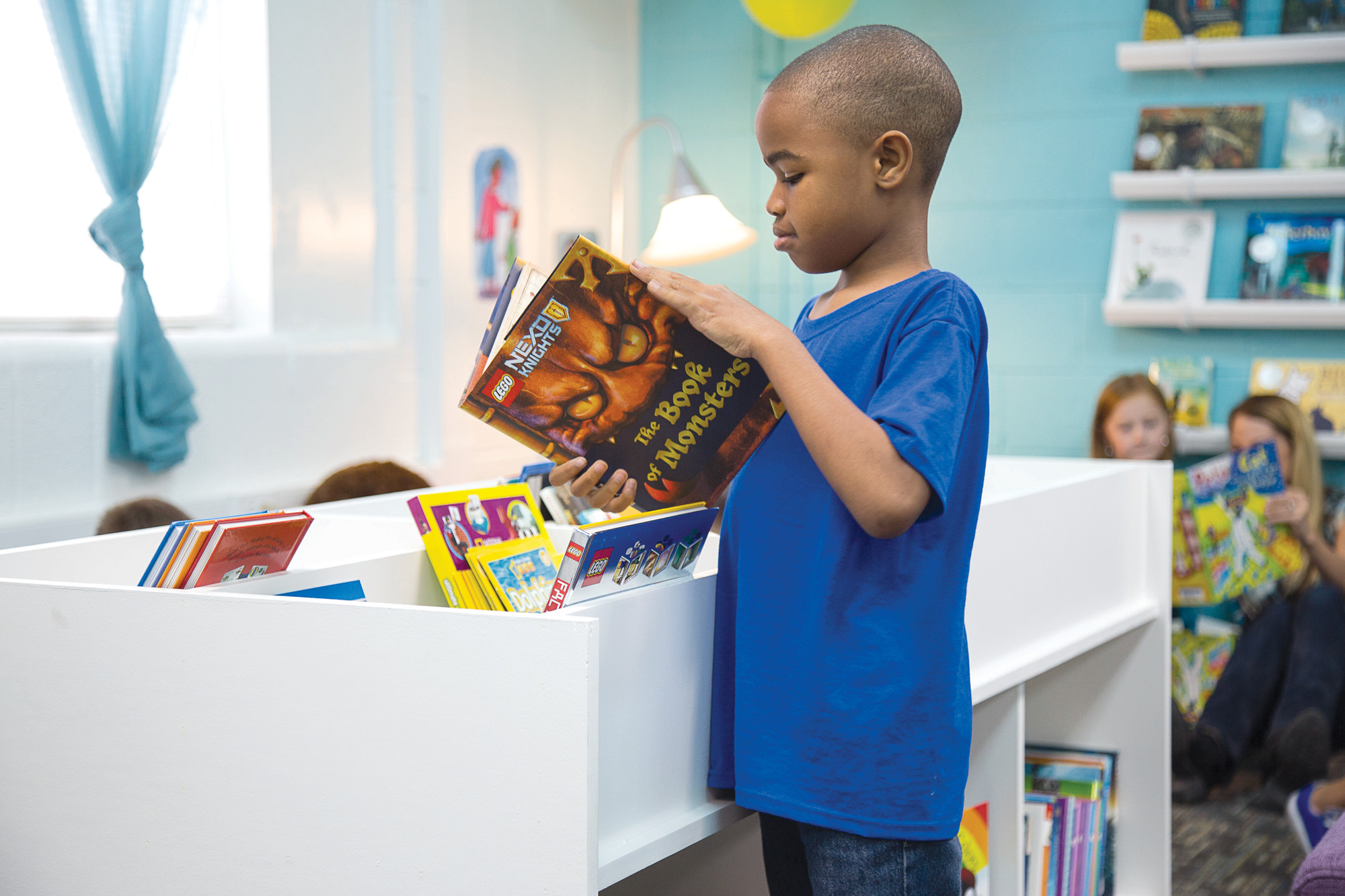 Books in the room are not organized in any special way, and the mission is for elementary school students to develop a joy for reading.