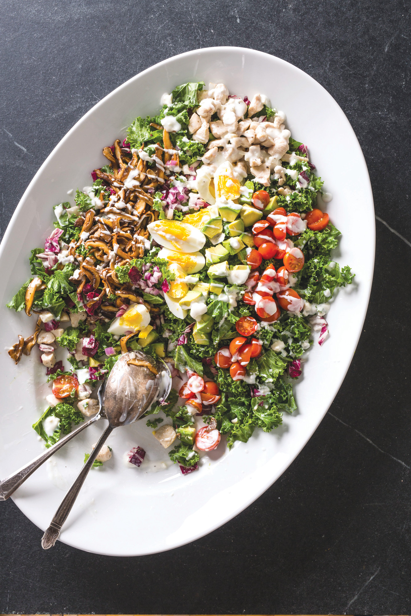 "THE ASSOCIATED PRESSThis photo provided by America's Test Kitchen in May 2018 shows a super Cobb salad in Brookline, Massachusetts. This recipe appears in the cookbook ""Nutritious Delicious."""