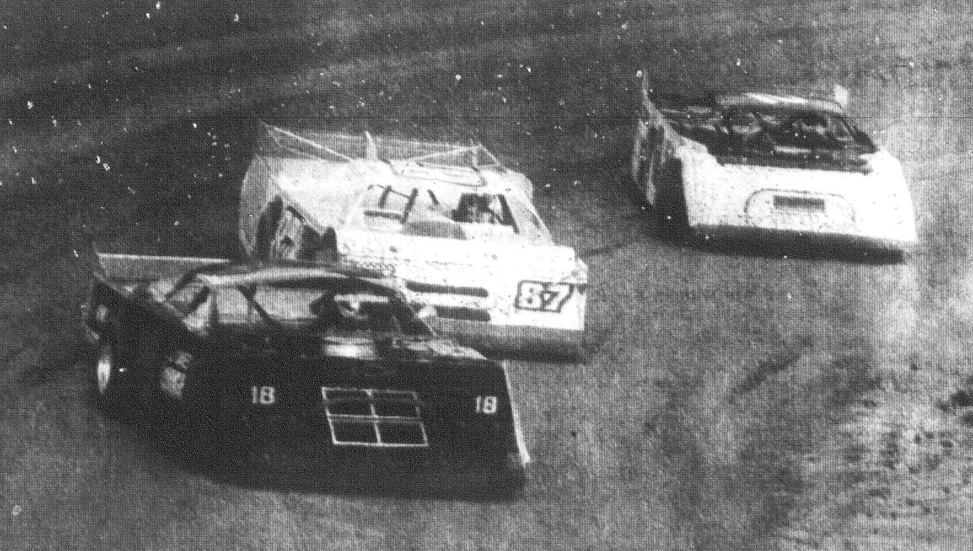 1993 - Late-model drivers Mike Carter of Hemingway, Lee Mintz of Columbia and Marion Sizemore of Jacksonville, Florida, get in some laps before the main event at Sumter Rebel Speedway.