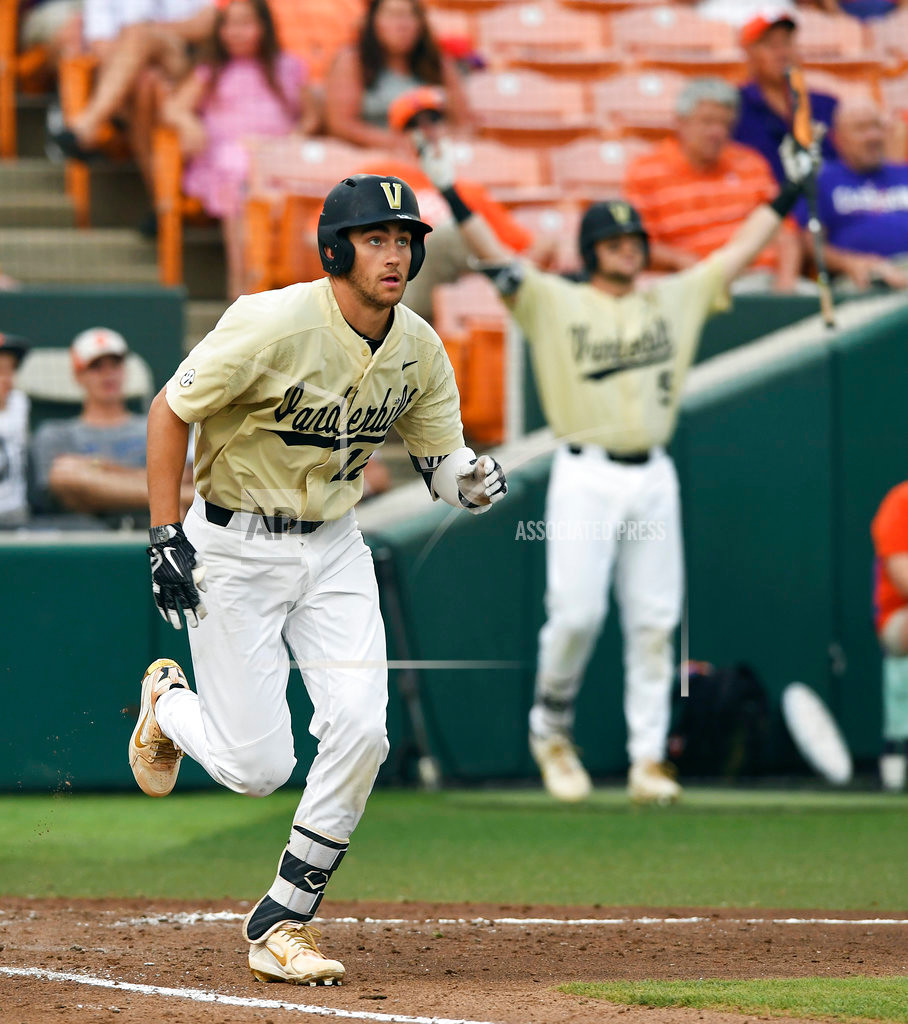 Vanderbilt's Connor Kaiser (12) hits a grand slam in the sixth inning of the Commodores' 19-6 victory over Clemson in the championship game of the Clemson regional on Sunday in Clemson. The Tigers were eliminated from the NCAA tournament with the loss.
