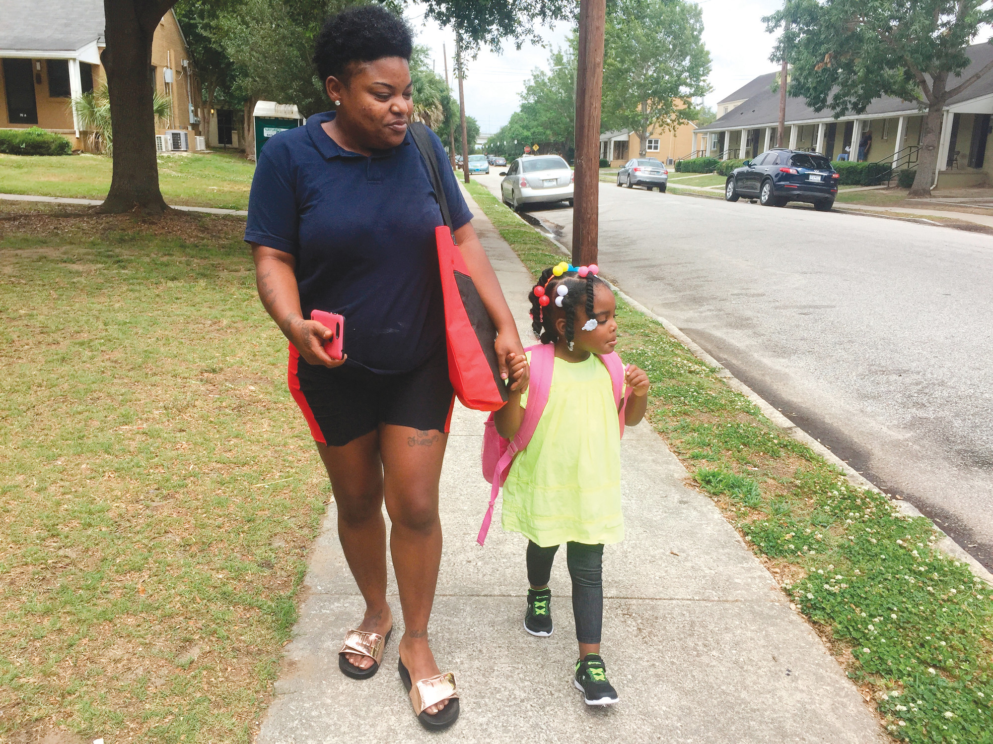 Shannon Brown, 29, walks with her four-year-old daughter,   Sai-Mya, in Charleston on May 17. Brown lives in public housing and could face a steep increase under a HUD   proposal that would raise rents for millions of low-income individuals and families.