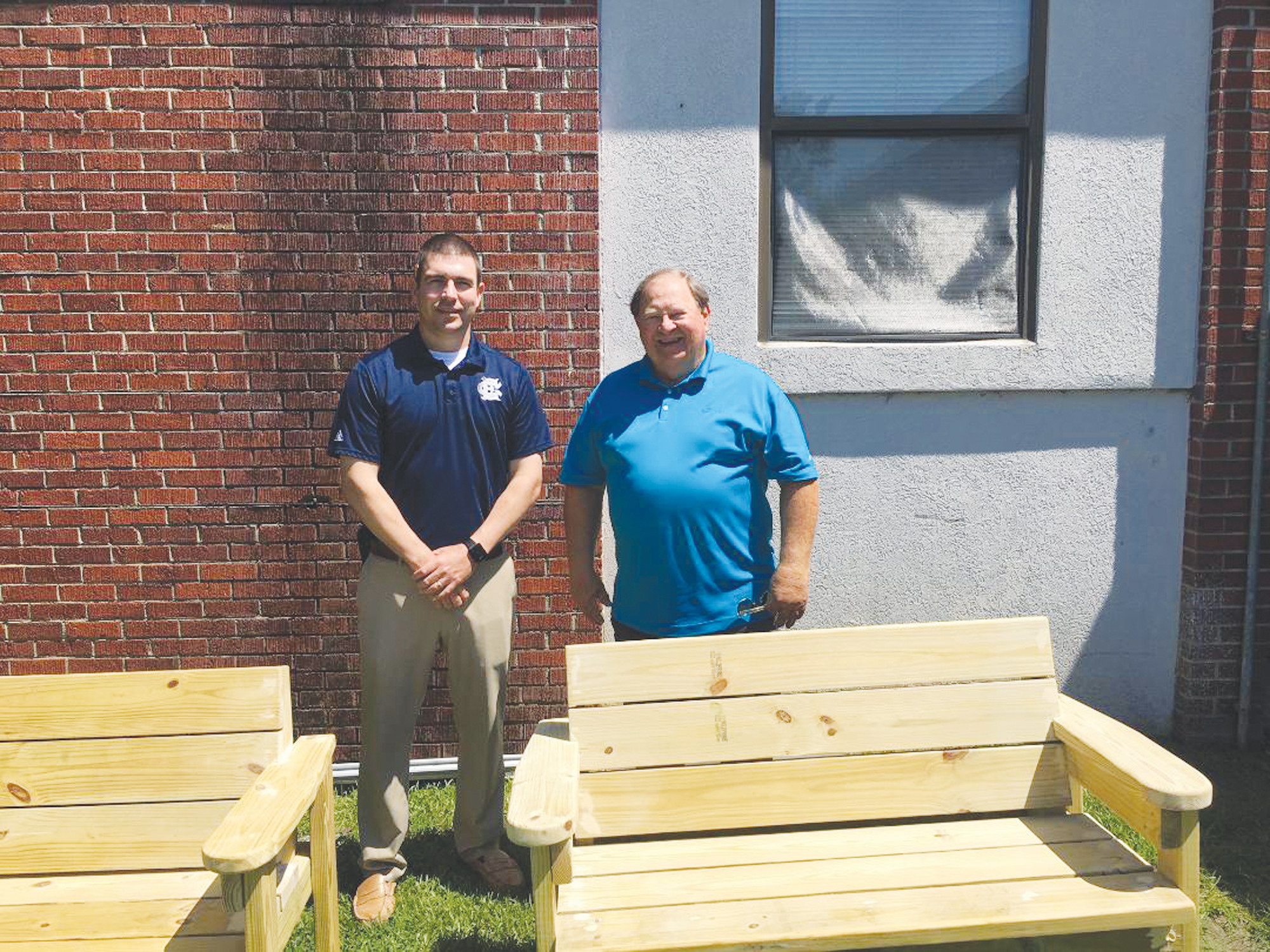 Clarendon County Councilman Benton Blakely, right, dropped off a pair of Buddy Benches that he, his grandsons, Evan and Colin Myers, and his son-in-law, Nick Myers, built recently. Walker-Gamble Elementary Principal Allen Kirby accepted the gift on behalf of the school and its students.