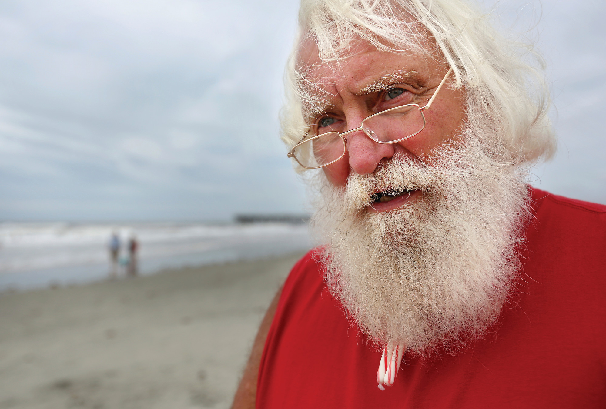Howard Hogue, also known as Beach Santa, pauses on the beach on the Isle of Palms.
