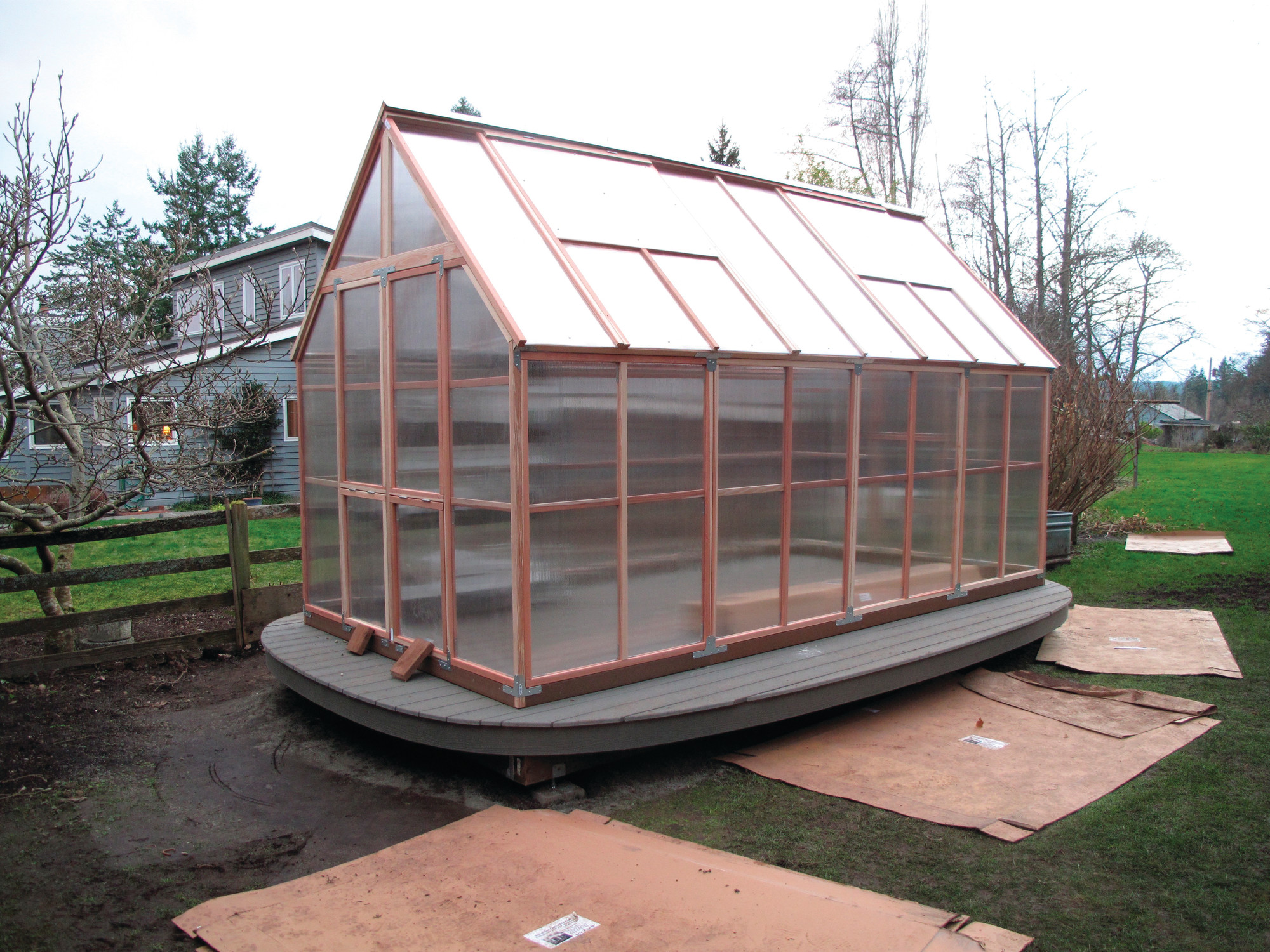 A hobby greenhouse is seen in February in Langley, Washington, built in a sunny location capable of capturing an immense amount of summertime heat. It was later equipped with a timed irrigation system that automatically turns on early in the morning to water a wide assortment of potted plants. Smart devices are being introduced to make gardening less demanding and more efficient.