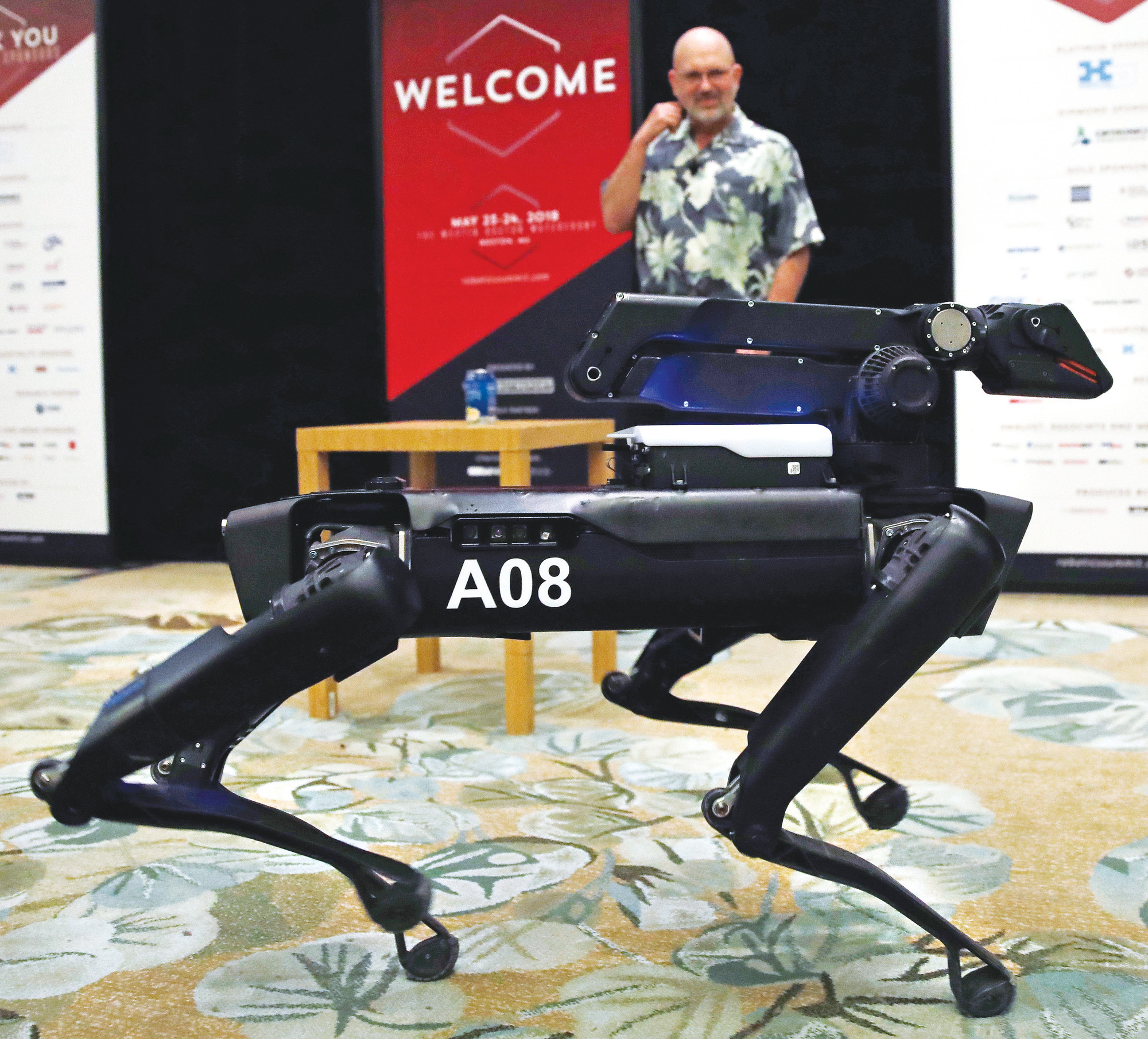 THE ASSOCIATED PRESS  In this May 24, photo a Boston Dynamics SpotMini robot walks through a conference room during a robotics summit in Boston.