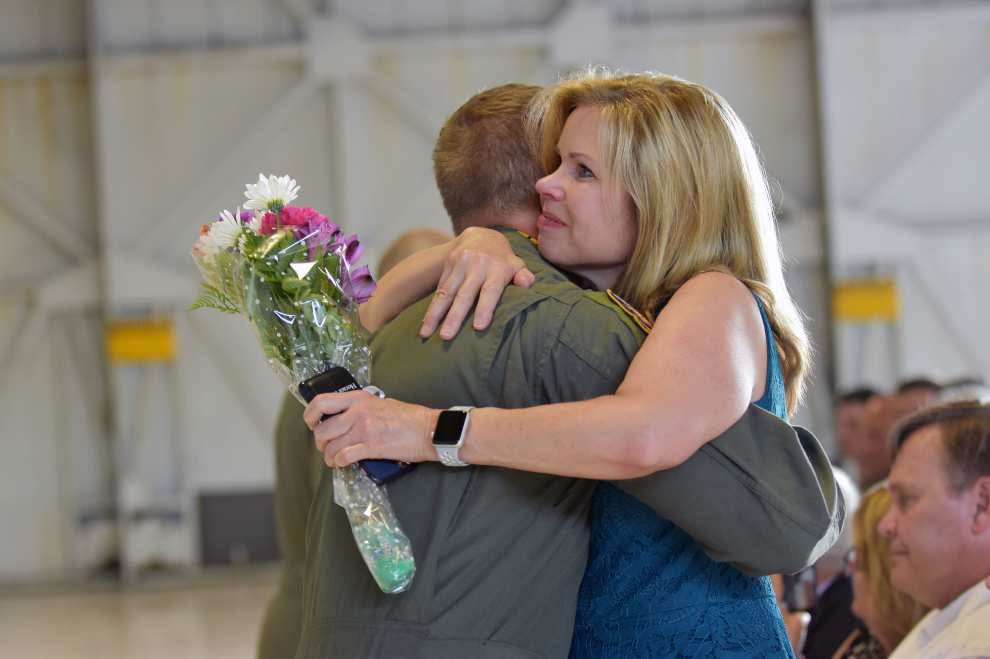 Capt. Salvador Cruz hugs his mother during his DFC Medal ceremony Thursday at Shaw Air Force Base.