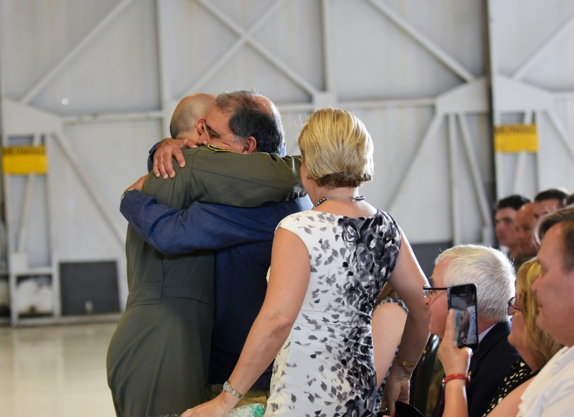 Capt. Salvador Cruz hugs his father during his DFC Medal ceremony Thursday at Shaw Air Force Base.