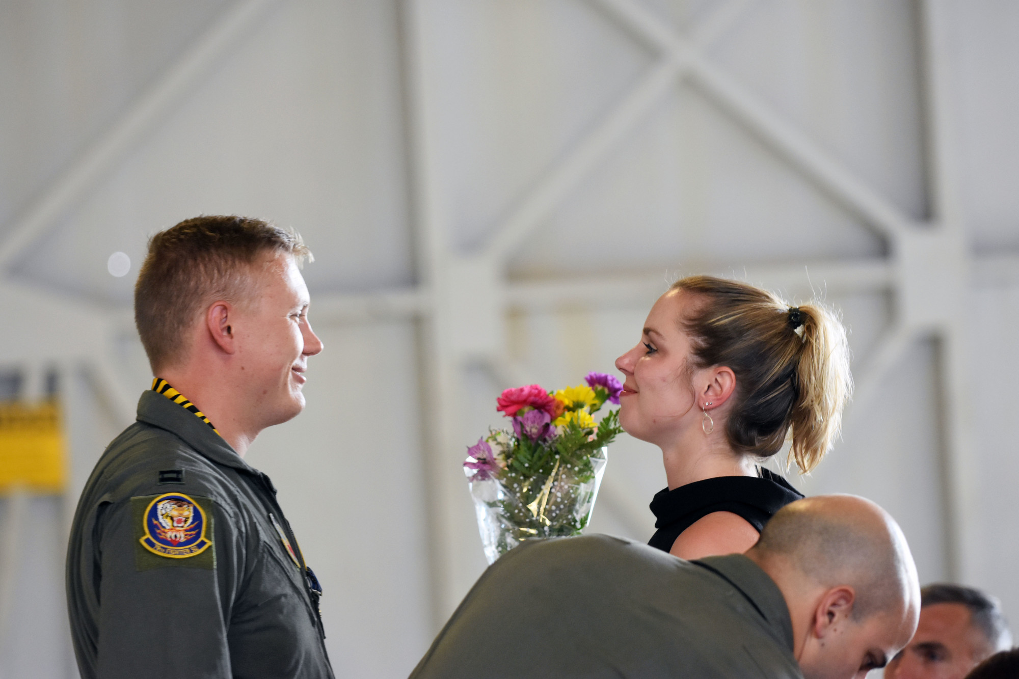 Capt. John Nygard shares a moment with his wife, Laura, after giving her flowers at his DFC Medal ceremony Thursday at Shaw Air Force Base.