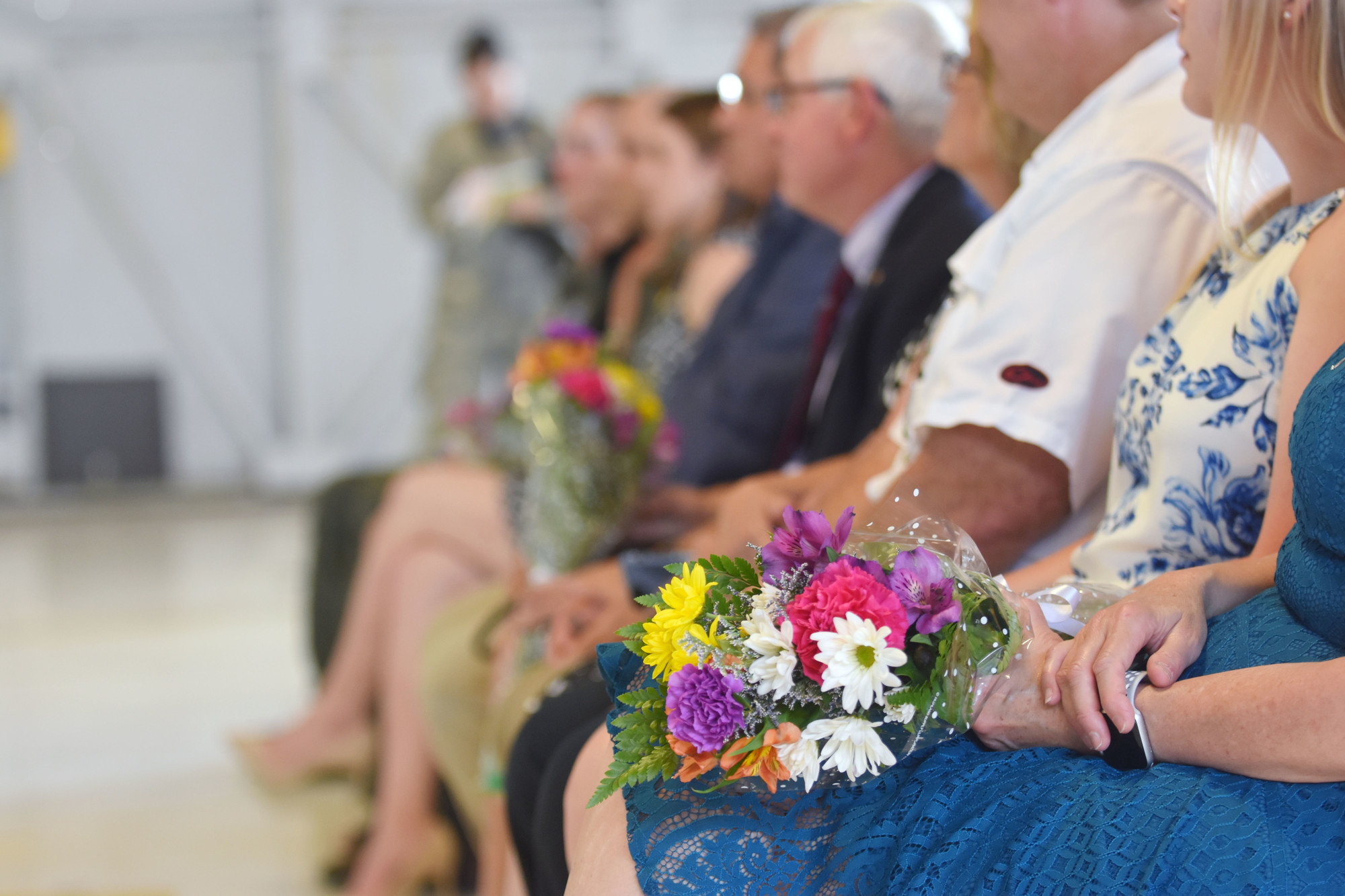 Capts. John Nygard and Salvador Cruz gave flowers to their wives and mothers and the mothers of the two airmen killed during the mission where they saved 88 airmen, which resulted in the captains receiving a DFC Medal.