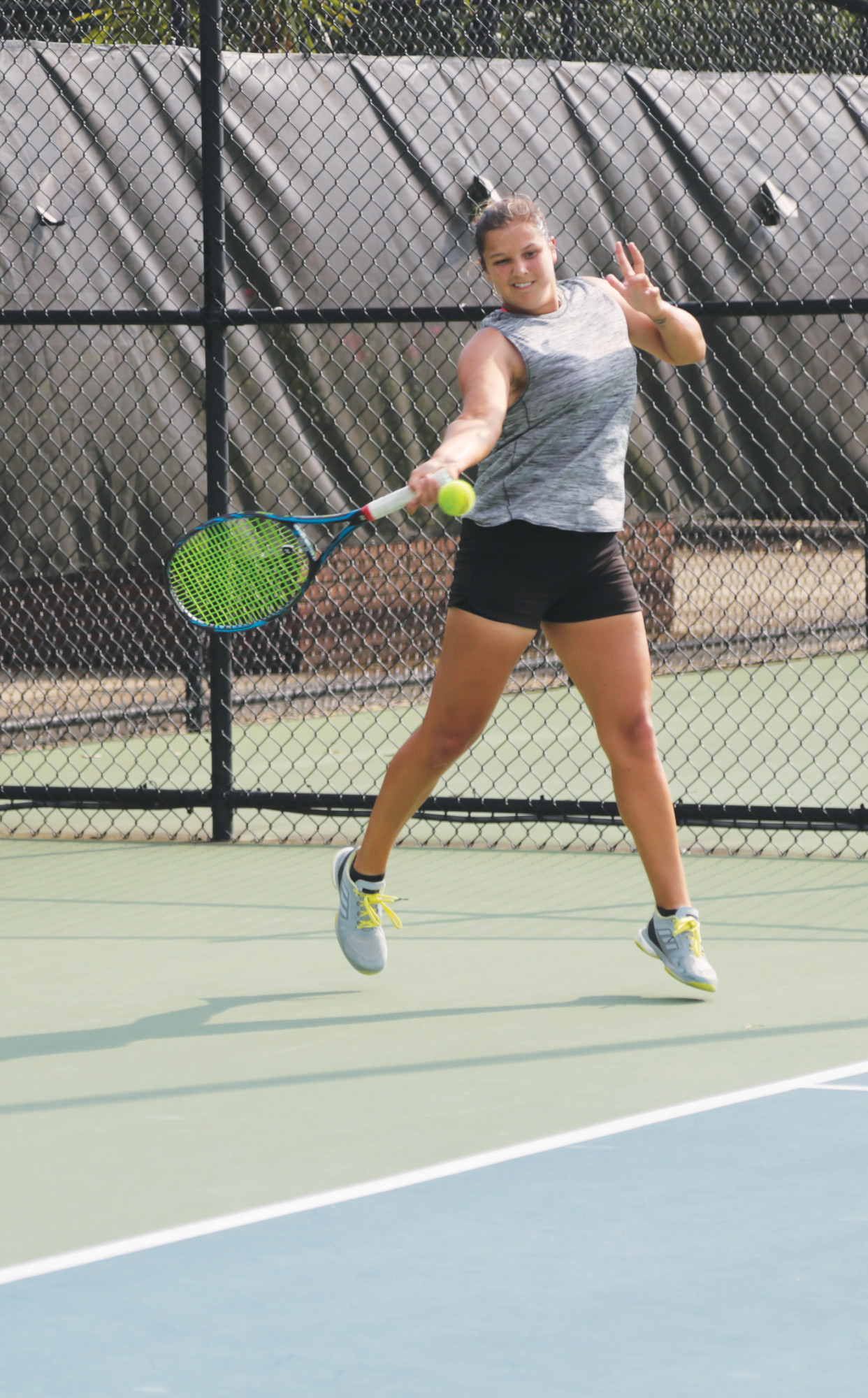 Lauren Proctor returns a shot during a doubles qualifying match in the Palmetto Pro Open at Palmetto Tennis Center on Monday. Proctor teamed with Alice Garcia to defeat Robin Anderson and Alize Lim 3-6, 6-2, (10-5).