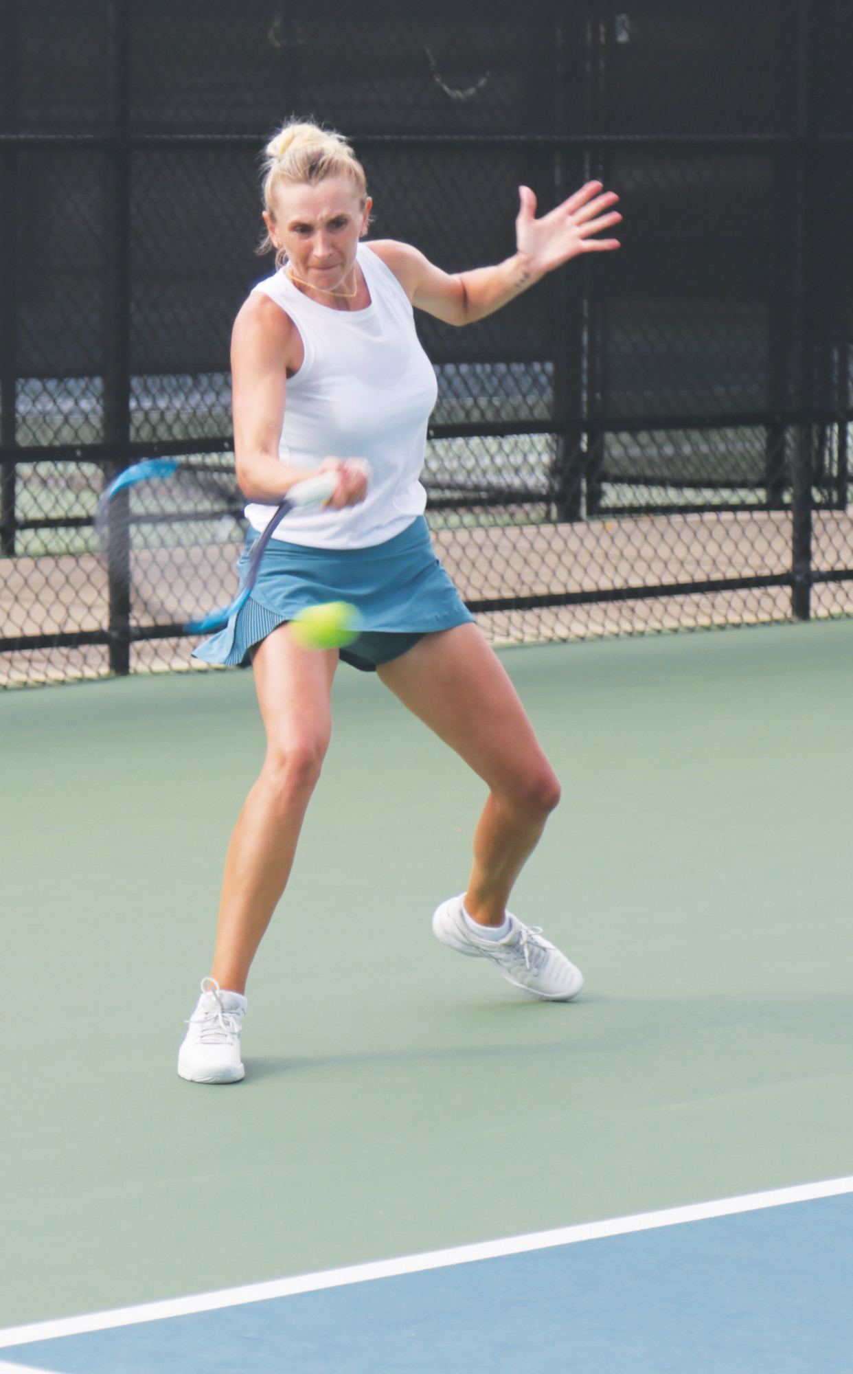 Olga Govortsova hits a forehand return in her 7-6(3), 7-5 victory over Adriana Reami on Monday in the second round of the qualifying draw of the Palmetto Pro Open at Palmetto Tennis Center.
