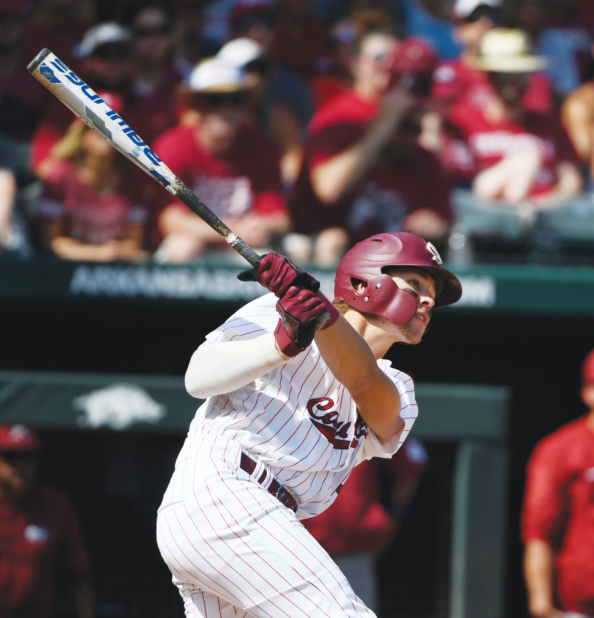 South Carolina's LT Tolbert (11) watches the ball after hitting a grand slam home run against Arkansas in the fifth inning of their NCAA baseball super regional  game in Fayetteville, Arkansas, on Sunday.