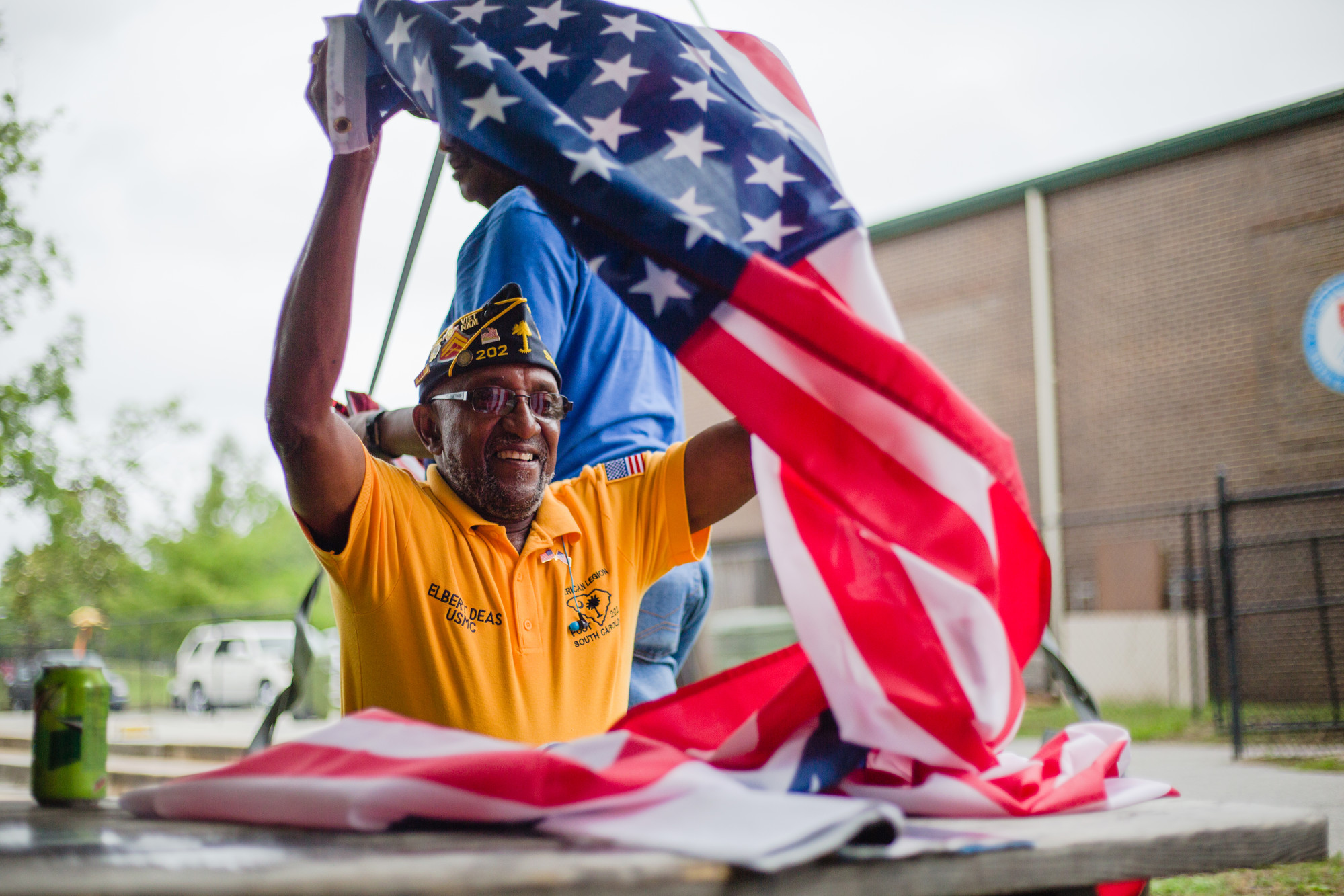Retired Marine Corp. Elbert Deas helps fold flags at South Sumter Park after the annual Memorial Day Fish Fry.