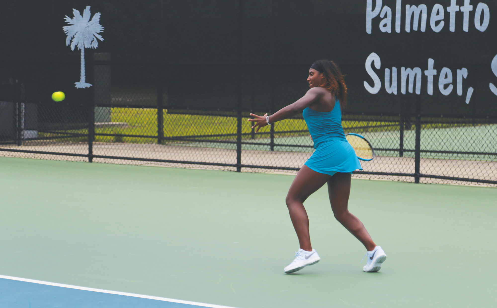 Hailey Baptiste prepares to return a shot during her 6-3, 6-3 victory over Genevieve Lorbergs in their singles qualifying final match on Tuesday in the Palmetto Pro Open at Palmetto Tennis Center. Baptiste advanced to the main draw, which begins today.