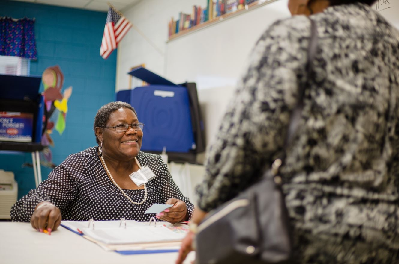 Irene Lucky Harris works at the Wilson Hall voting precinct on Tuesday.