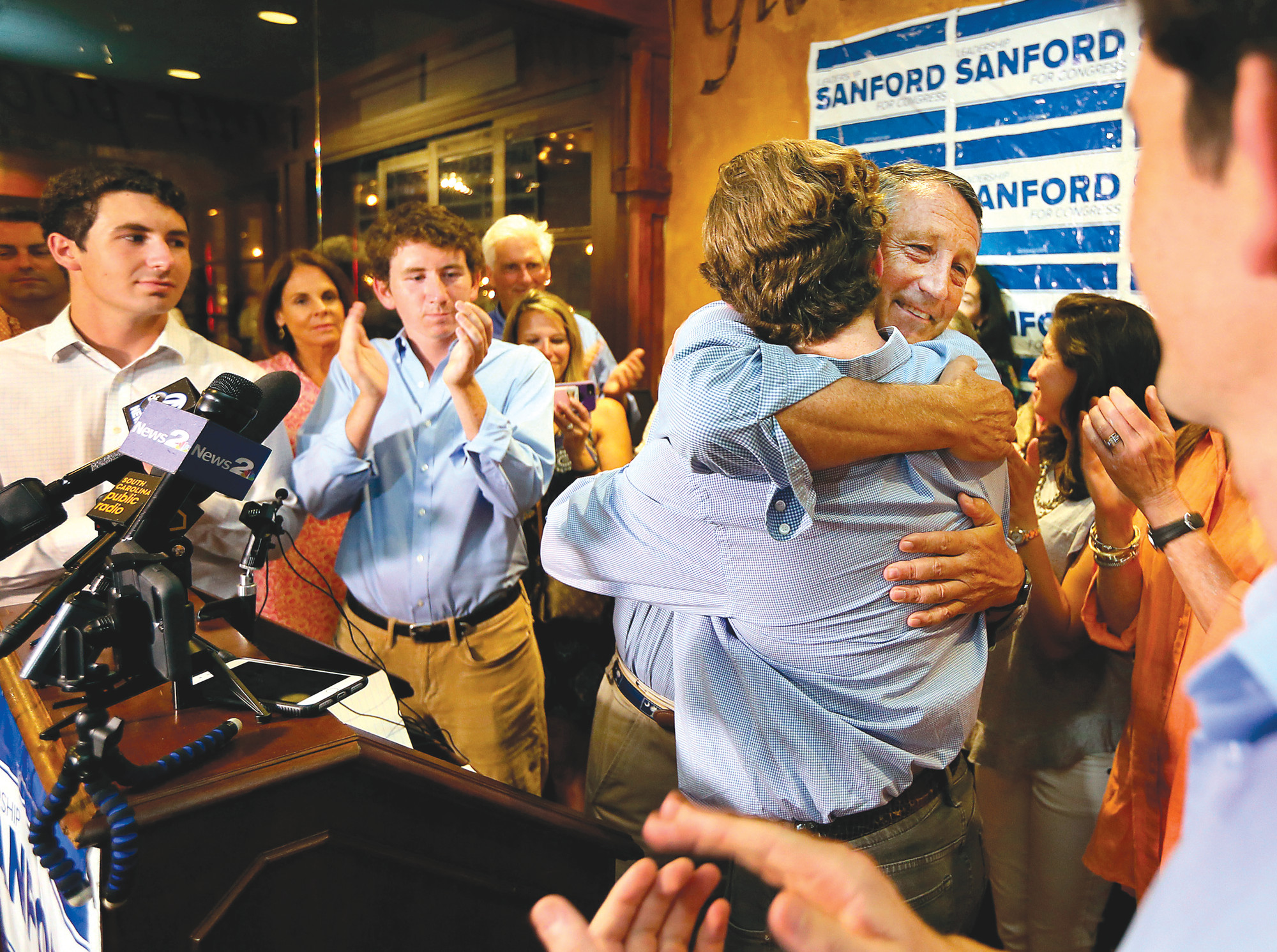 U.S. Rep. Mark Sanford hugs his sons after addressing his supporters at Liberty Tap Room in Mount Pleasant on Tuesday. Sanford lost his first election ever Tuesday, beaten for the Republican nomination for another term in the coastal 1st District around Charleston by state Rep. Katie Arrington.