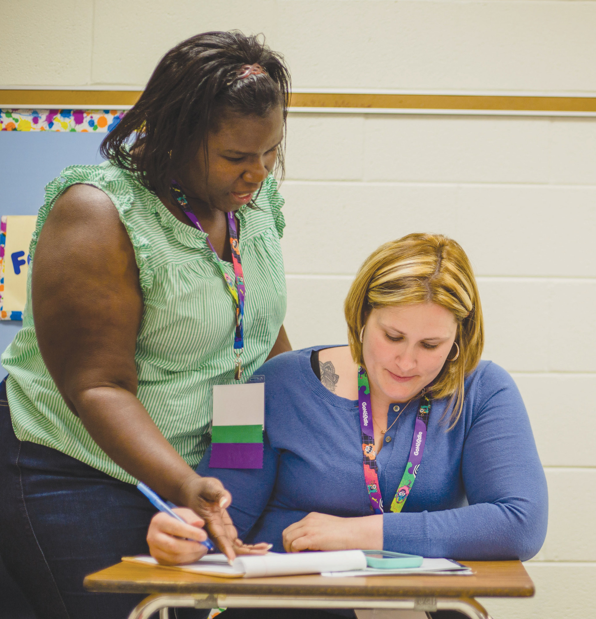Marlissa Morton goes over information with Beverly Bearor during Wednesday's sessions.