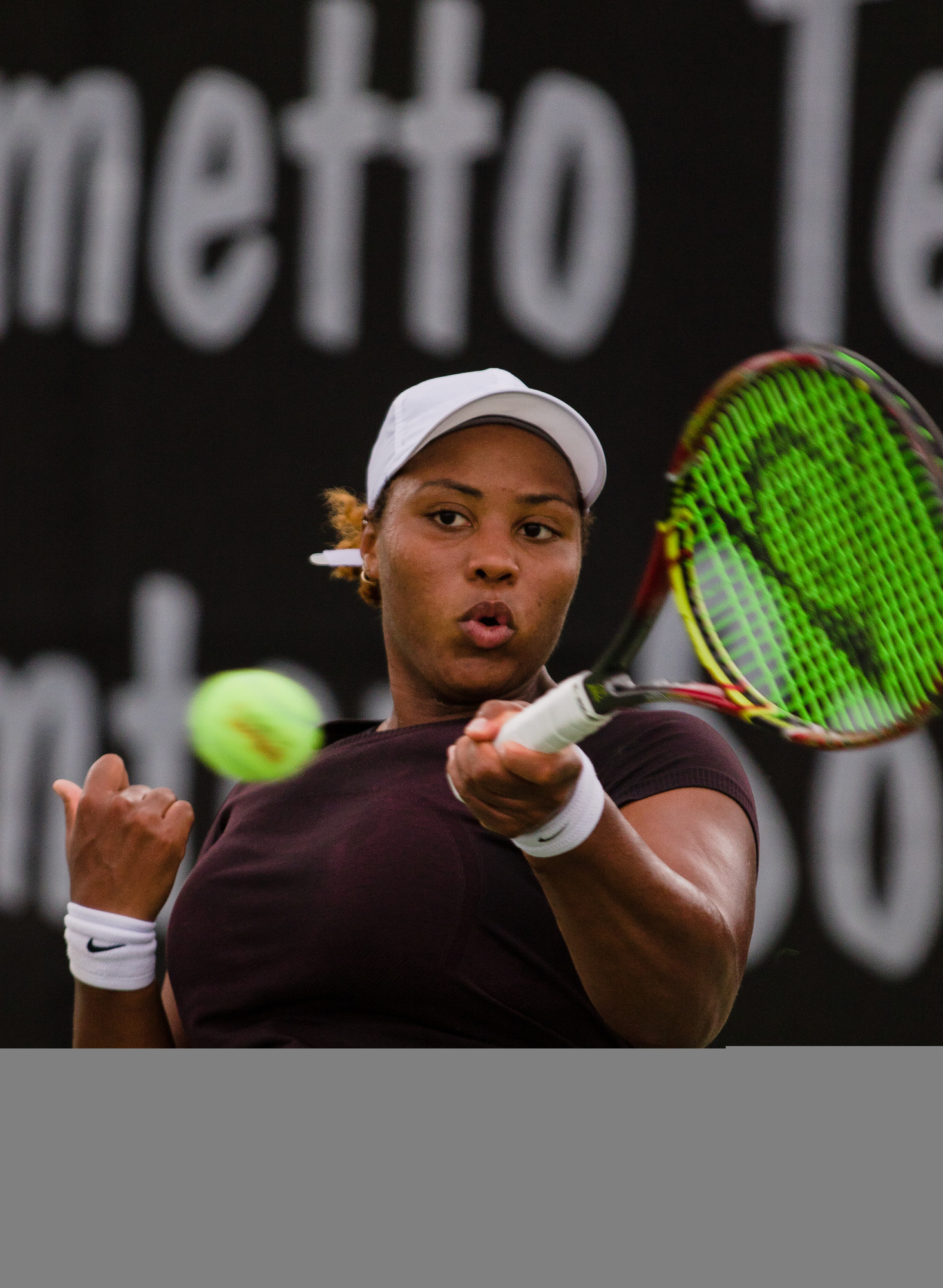 Top-seeded Taylor Townsend eyes a volley during her first-round match with Astra Sharma in the Palmetto Pro Open on Wednesday at Palmetto Tennis Center. Townsend survived a tough match, winning 7-5, 7-6(7) to advance.