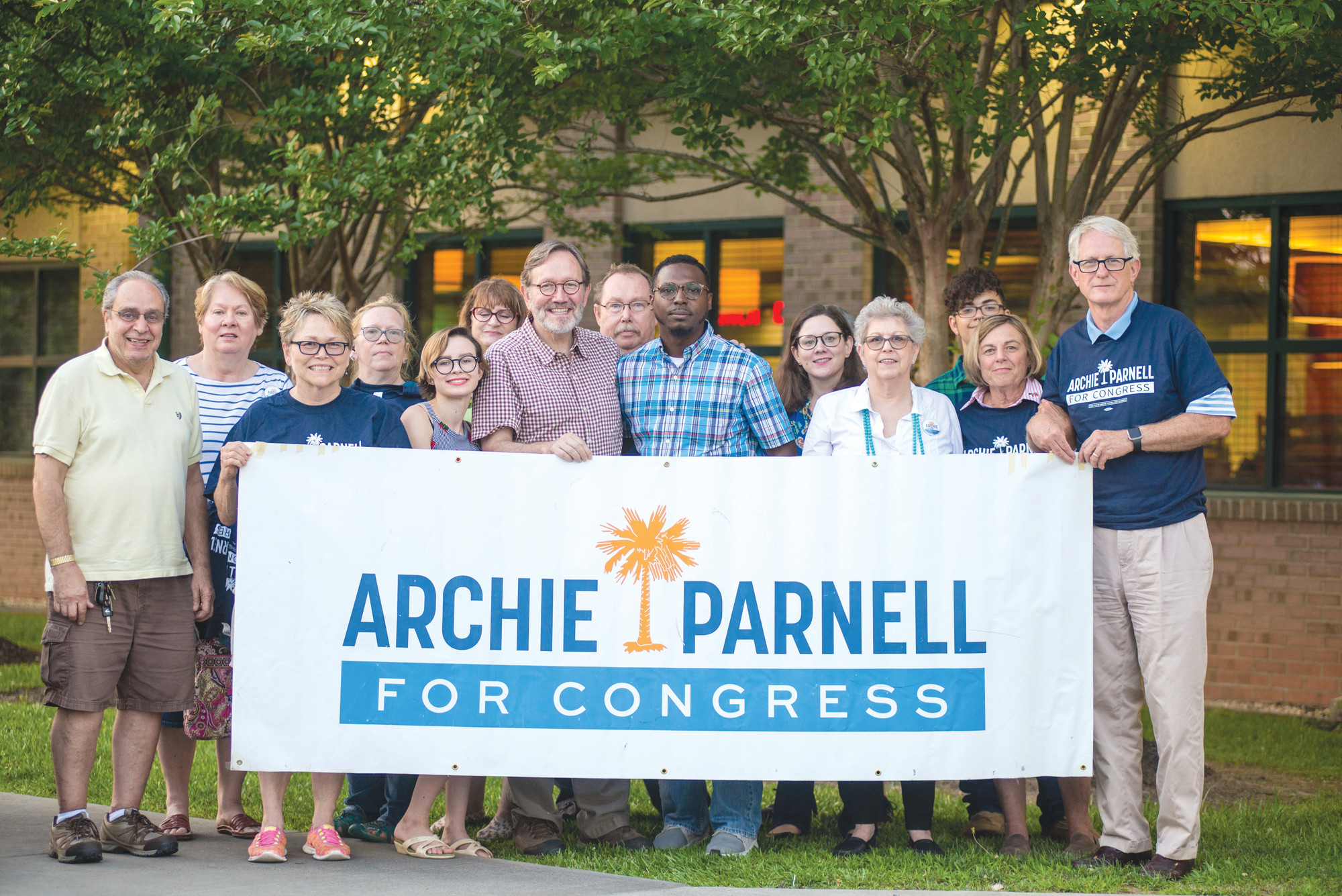 Archie Parnell is seen with a group of supporters recently.