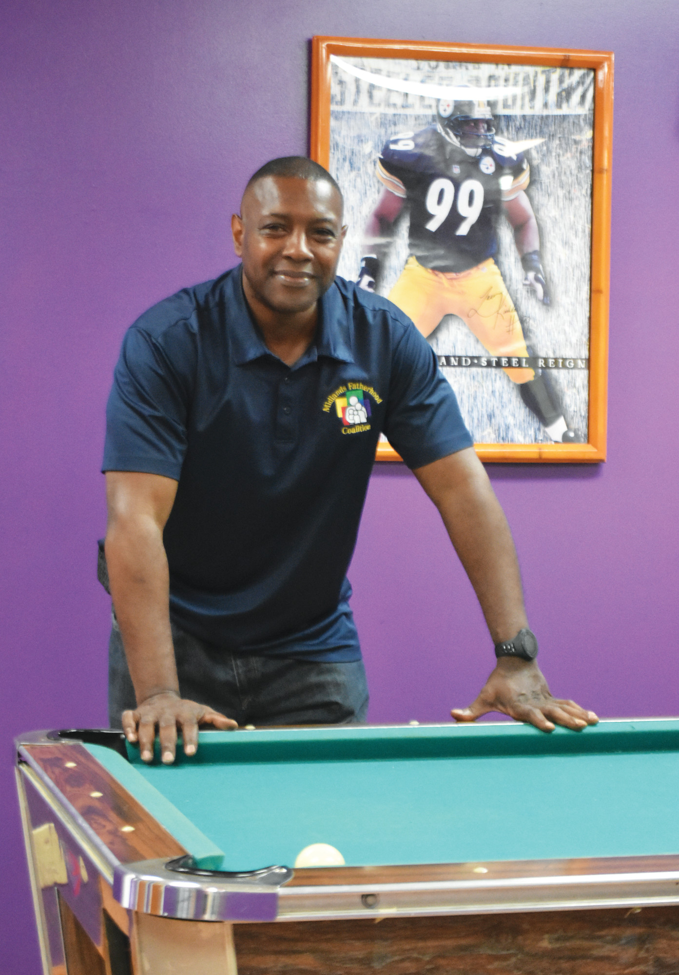 "Keith Ivey, site director, stands in the ""dad cave"" at the Midlands Fatherhood Coalition - Sumter building. The office has a space for men to relax and feel comfortable while they tackle what life is throwing at them.."