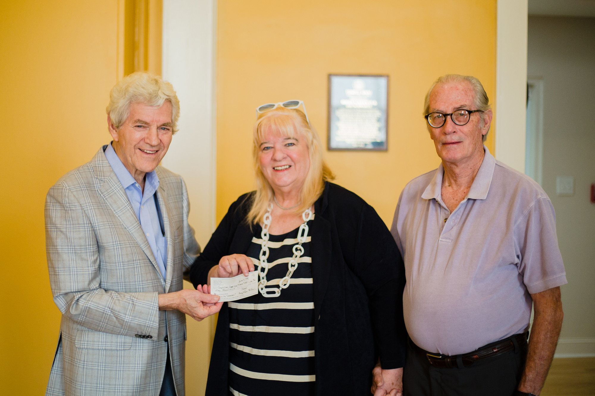 Roger Ackerman, Temple Sinai board member, left, is seen with Mary Ellen Donovan Fuller, center, who donated money recently to Sumter's Jewish History Center, and Fuller's husband, David.