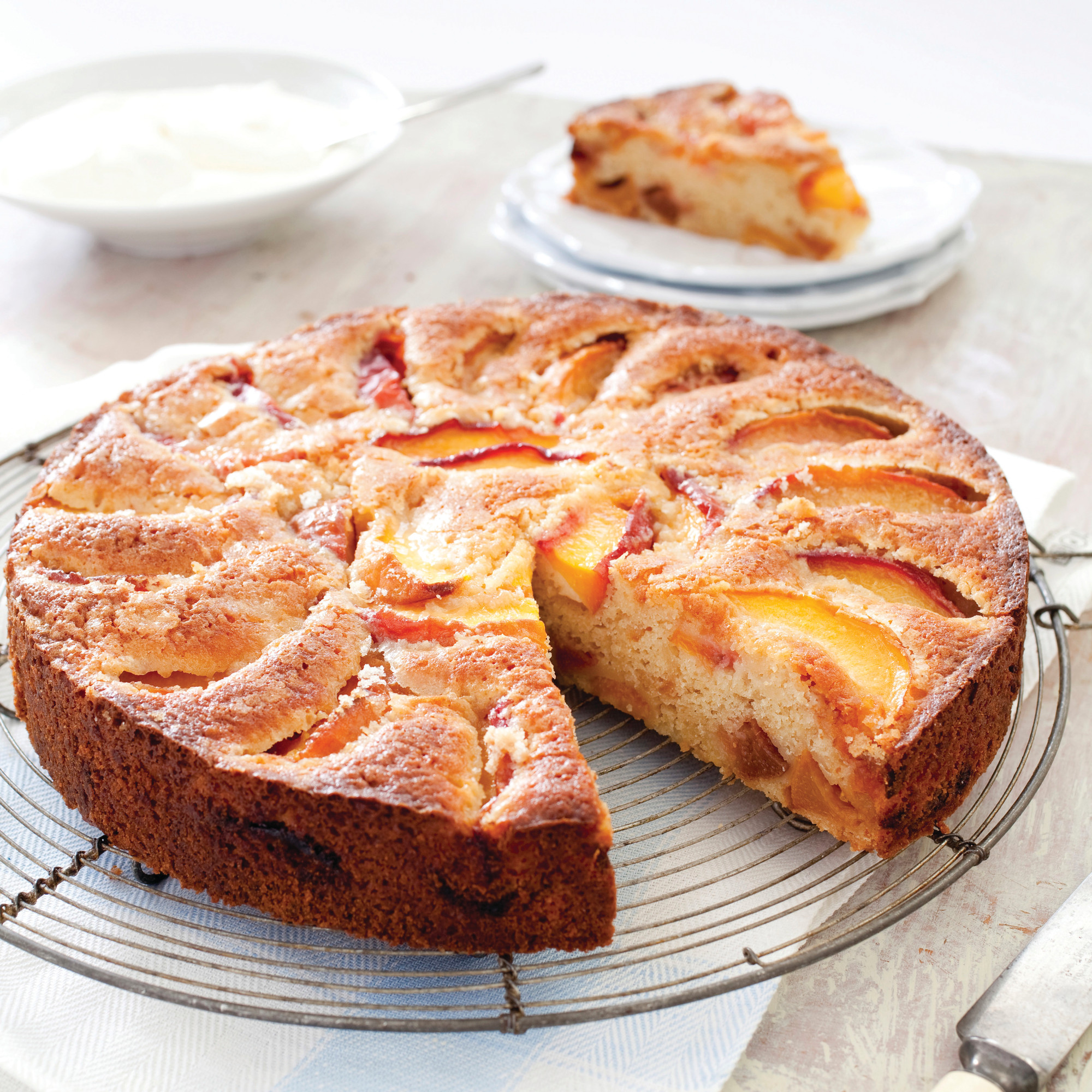 "The recipe for Summer Peach Cake appears in the cookbook ""The Perfect Cake."""