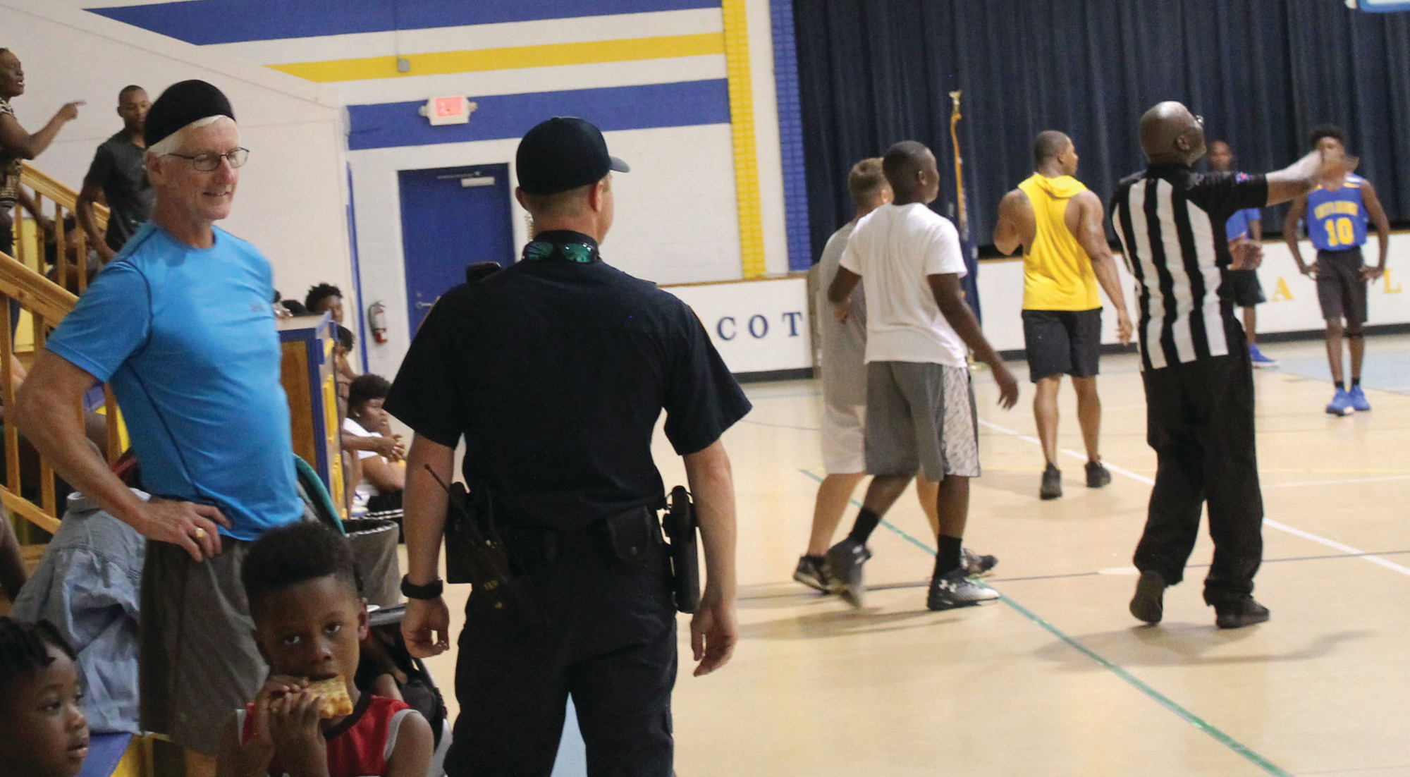 Clarendon County Sheriff's Office Chief Deputy Gene Morris, left, chats with Lt. Matthew Stone before he takes the court in a basketball game between law enforcement officers and athletes from Scott's Branch High School on June 15 in Summerton as party of the first Ready. Set. Engage! event.