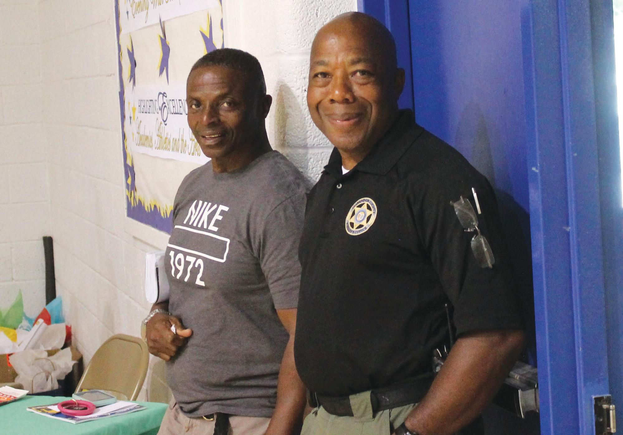Investigator Kenneth Clark with the Clarendon County Sheriff's Office offered moral support to his fellow law enforcement officers when they took the court against a few stellar athletes from Scott's Branch High School.