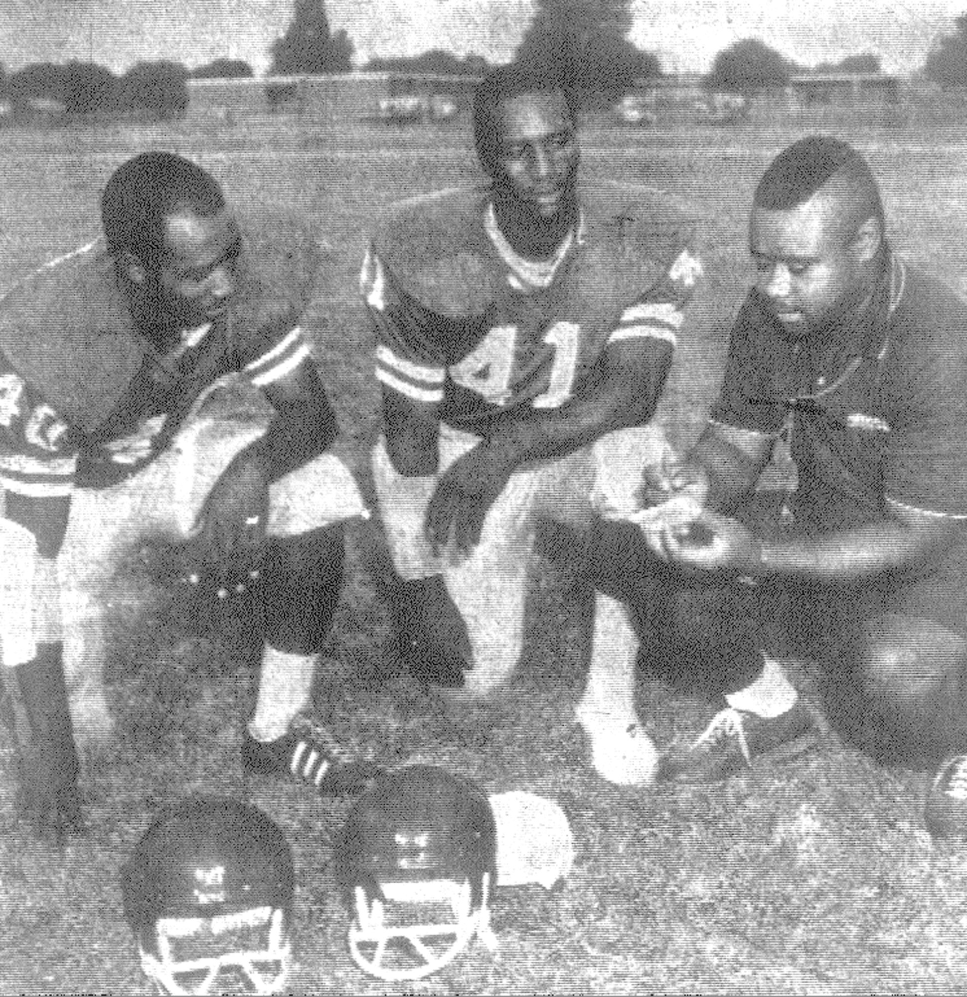 1968 - Lincoln High School Coach Joe Hoskins, right, talks with John Haynesworth, left, and Oliver Wells about a game with Manning.
