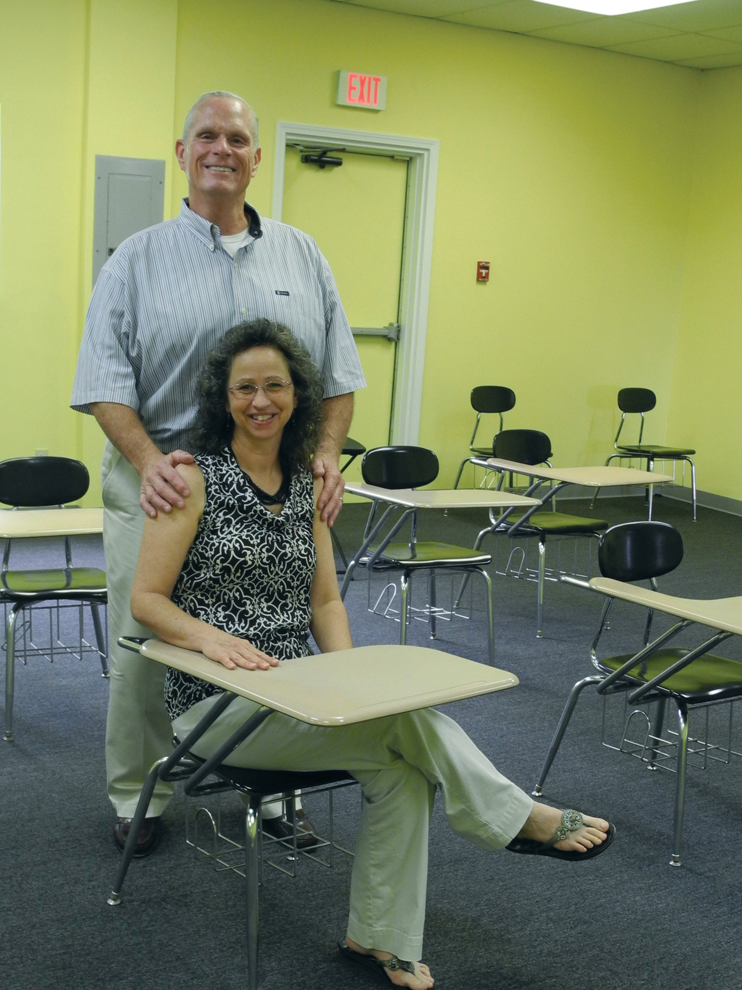 Sheila E Academy principal Allen Horn and his wife, Lisa Horn, are seen in a classroom at the school on Thomas Sumter Highway. They are preparing for the Aug. 20 opening of the new Christian school. Lisa Horn will serve the school as bookkeeper and secretary. The public is invited to learn more about the school and its mission at a meeting with the principal and other school staff at 6 p.m. Thursday at SEA, 4107 Thomas Sumter Highway (U.S. 521 North)