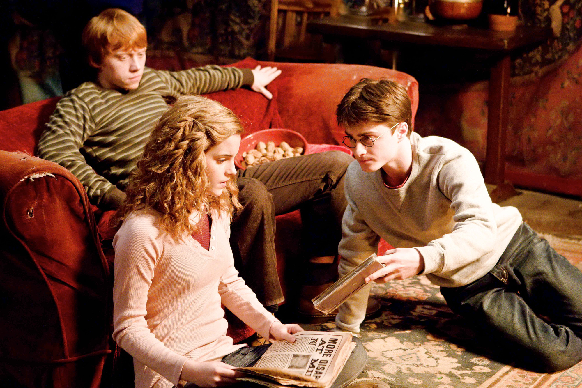 "From left, Rupert Grint stars as Ron Weasley, Emma Watson as Hermione Granger and Daniel Radcliffe as Harry Potter in a scene from ""Harry Potter and the Half-Blood Prince."" Beginning with ""Harry Potter and the Sorcerer's Stone"" at 8 p.m. today, both USA and Syfy will air all eight movies in the film series over the next three days and nights."