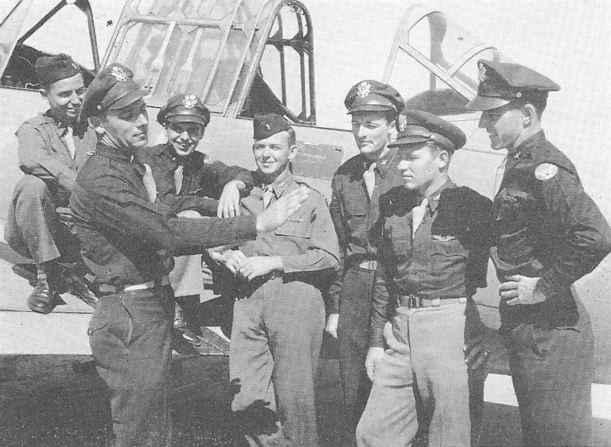 From left, Guy M. King, Clayton L. Berlinghoff, David G. Mullison, Irvin Croutherfield, Thomas E. Murray, J.M. Page, W. Laurent are seen in High Pitch magazine in 1943.