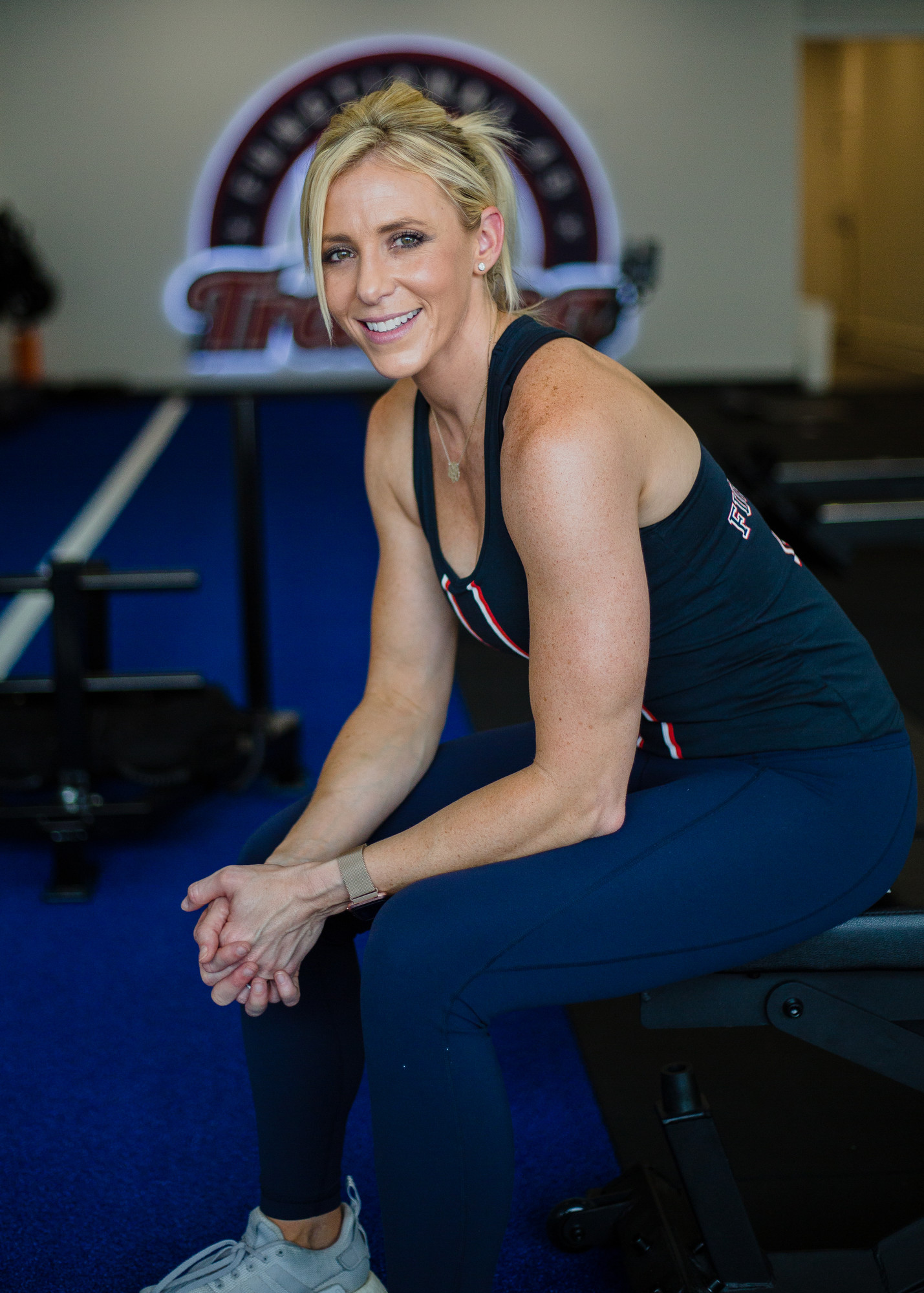 F45 Sumter General Manager Ashley Schwedler sits in the studio area to her new gym in the downtown area on Monday.