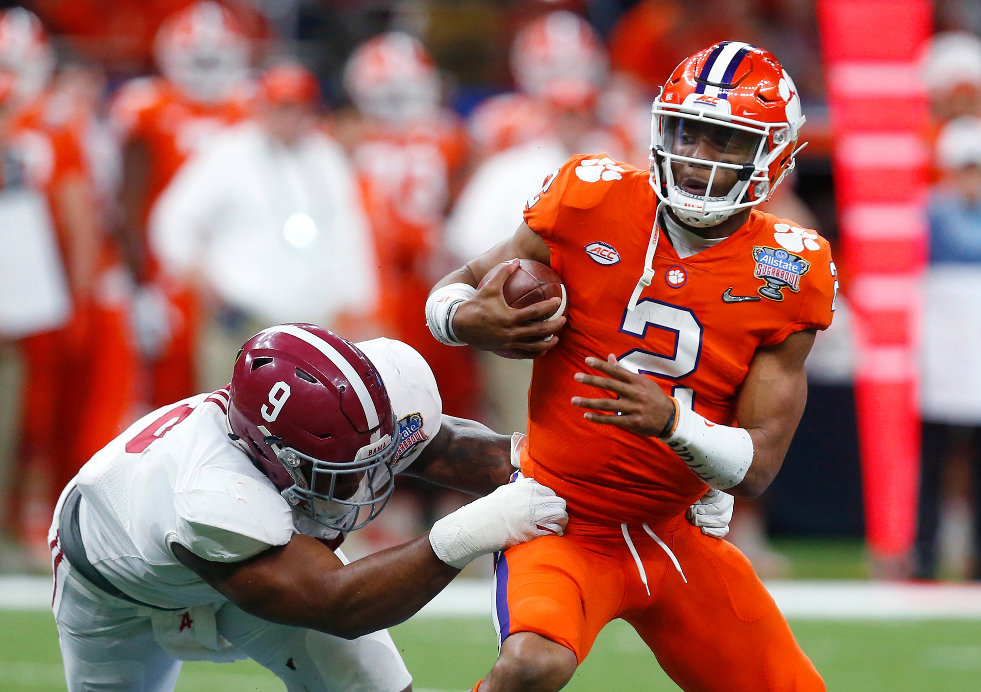THE ASSOCIATED PRESS  Clemson quarterback Kelly Bryant (2) is sacked by Alabama defensive lineman Da'Shawn Hand (9) in the Tigers' College Football Playoff loss last season. Clemson is hoping to use that loss as motivation for the upcoming season.