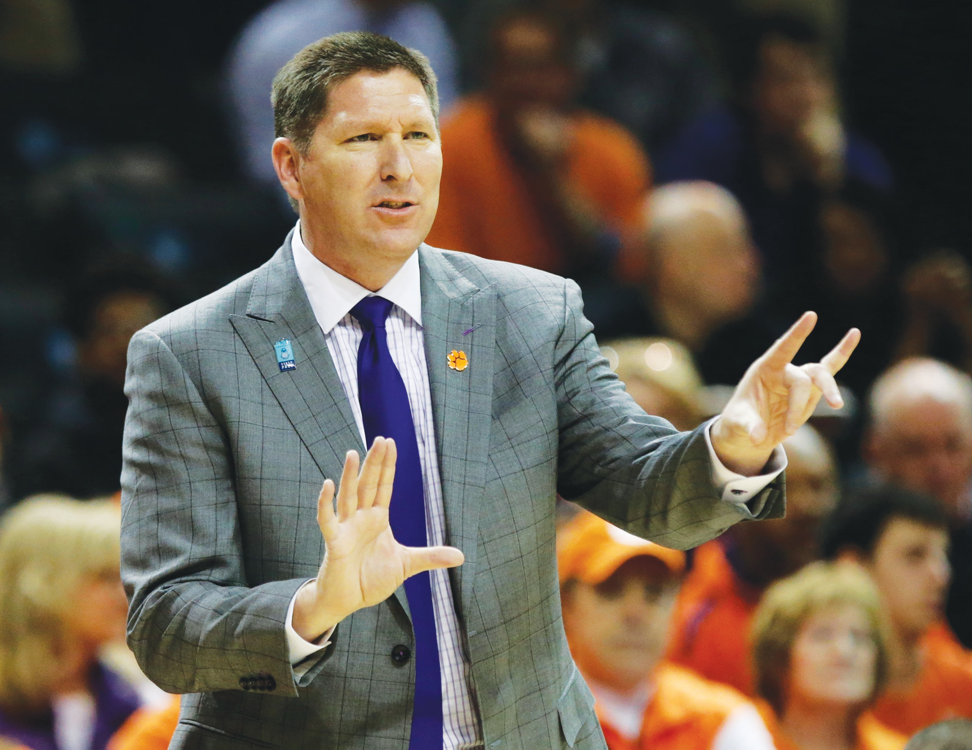 FILE - In this March 8, 2018, file photo, Clemson head coach Brad Brownell directs to his team during the first half of an NCAA college basketball game against Boston College in the quarterfinal round of the Atlantic Coast Conference tournament, in New York. Brownell has received a new six-year contract that will pay him $15 million through 2024. The school's compensation committee of the board of trustees approved the deal Thursday, July 19, 2018, for Brownell, who reached the round of the 16 i