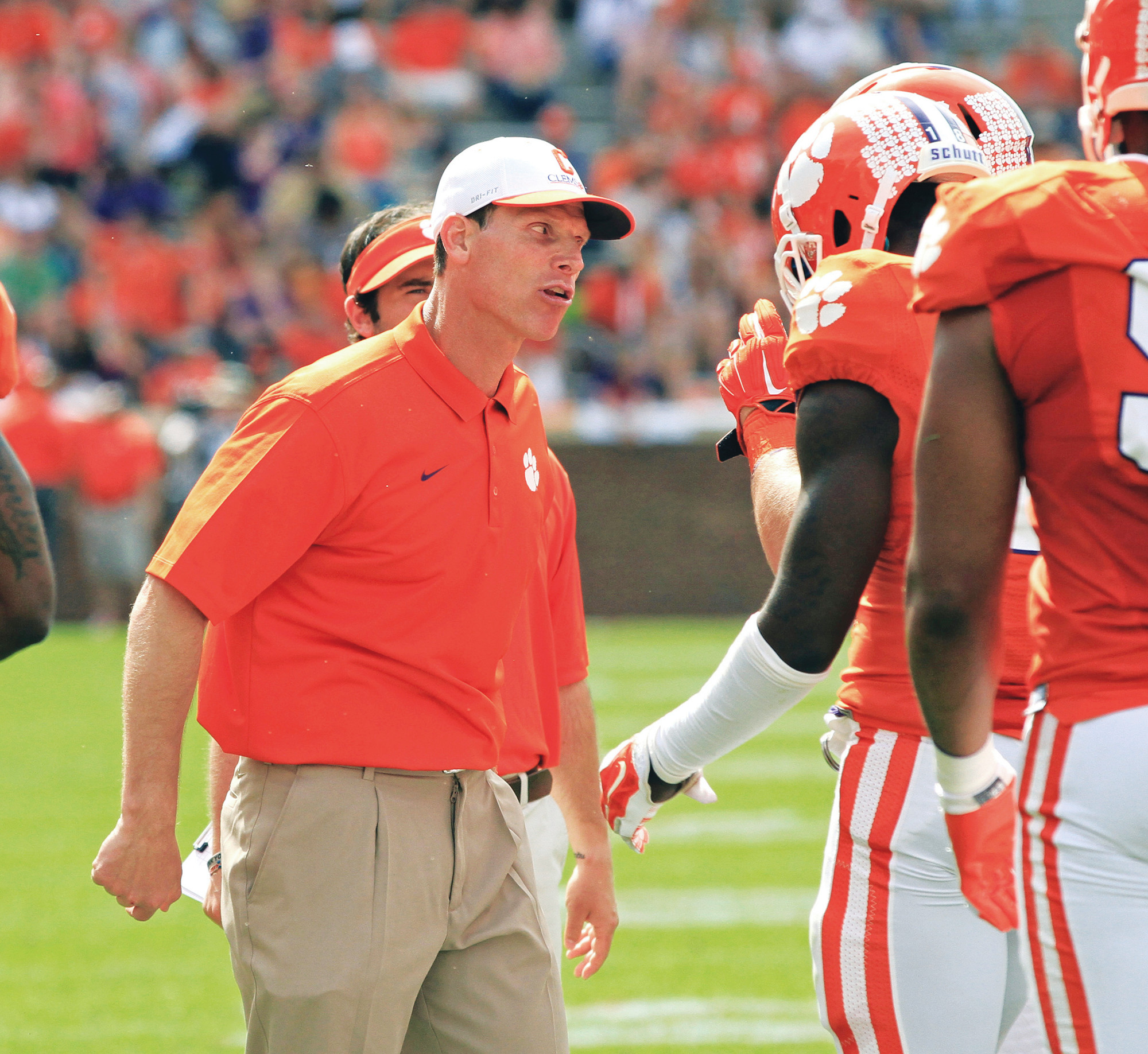 Clemson defensive coordinator Brent Venables, left, gets on a player during Clemson's spring game at Memorial Stadium in Clemson in April. Clemson has made a second major statement this year about how much they want to hold onto Venables. After upping his salary to $2 million a year in February, the school extended the deal to five seasons through 2022 and added retention bonuses that make the package worth $11.6 million.