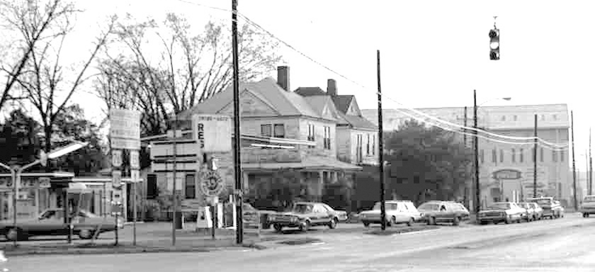 People wait in line to buy gas at the intersection of East Liberty Street and Lafayette Drive. The houses next door to the gas station were later torn down.