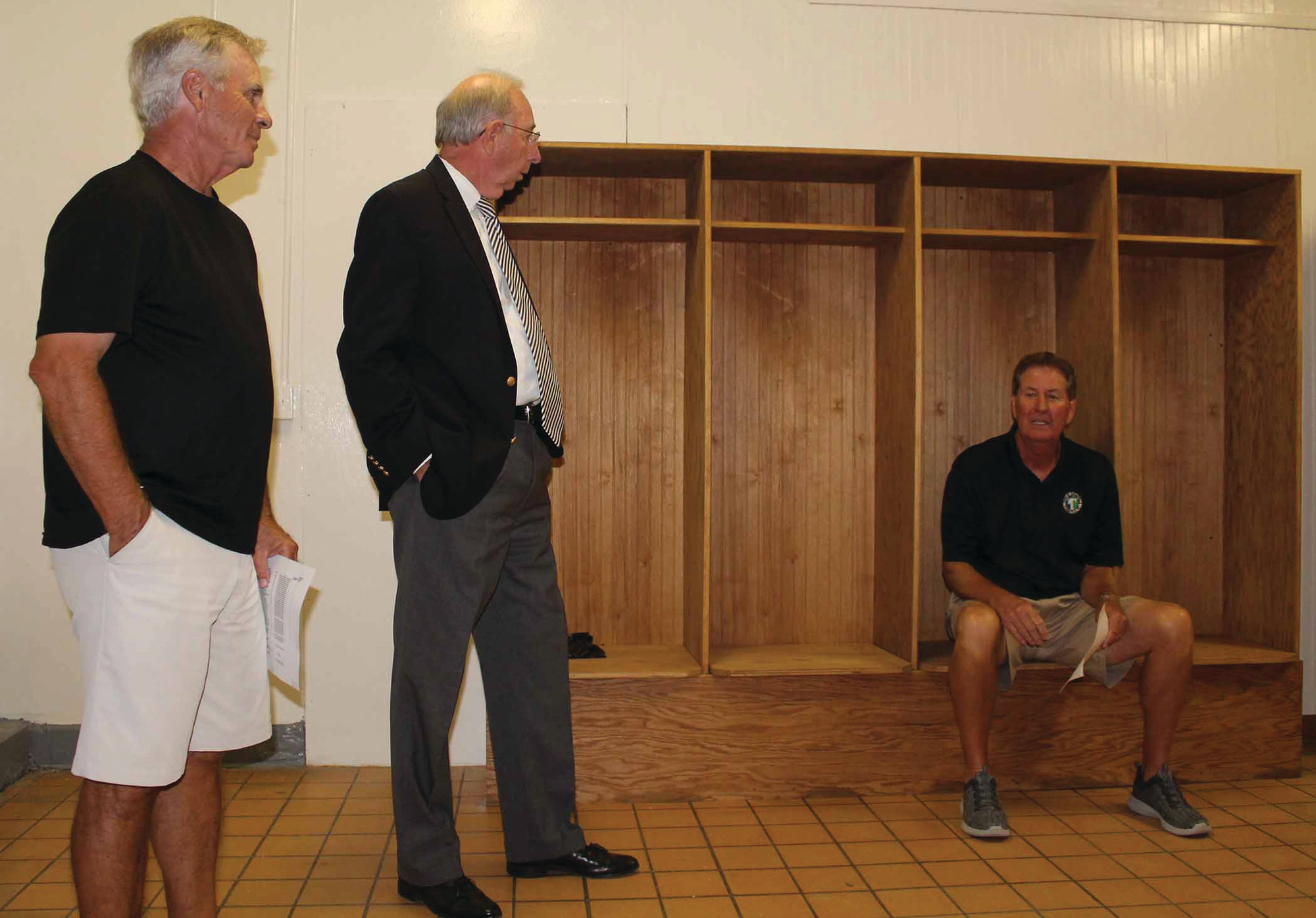 Donald Hardy, Blake Gibbons and Dwayne Howell are seen in the newly renovated girls' locker room at East Clarendon High School. The Citizens Bank of Turbeville, where Gibbons serves as president and chief operating officer, was one of several local businesses that made generous contributions toward the renovation project.